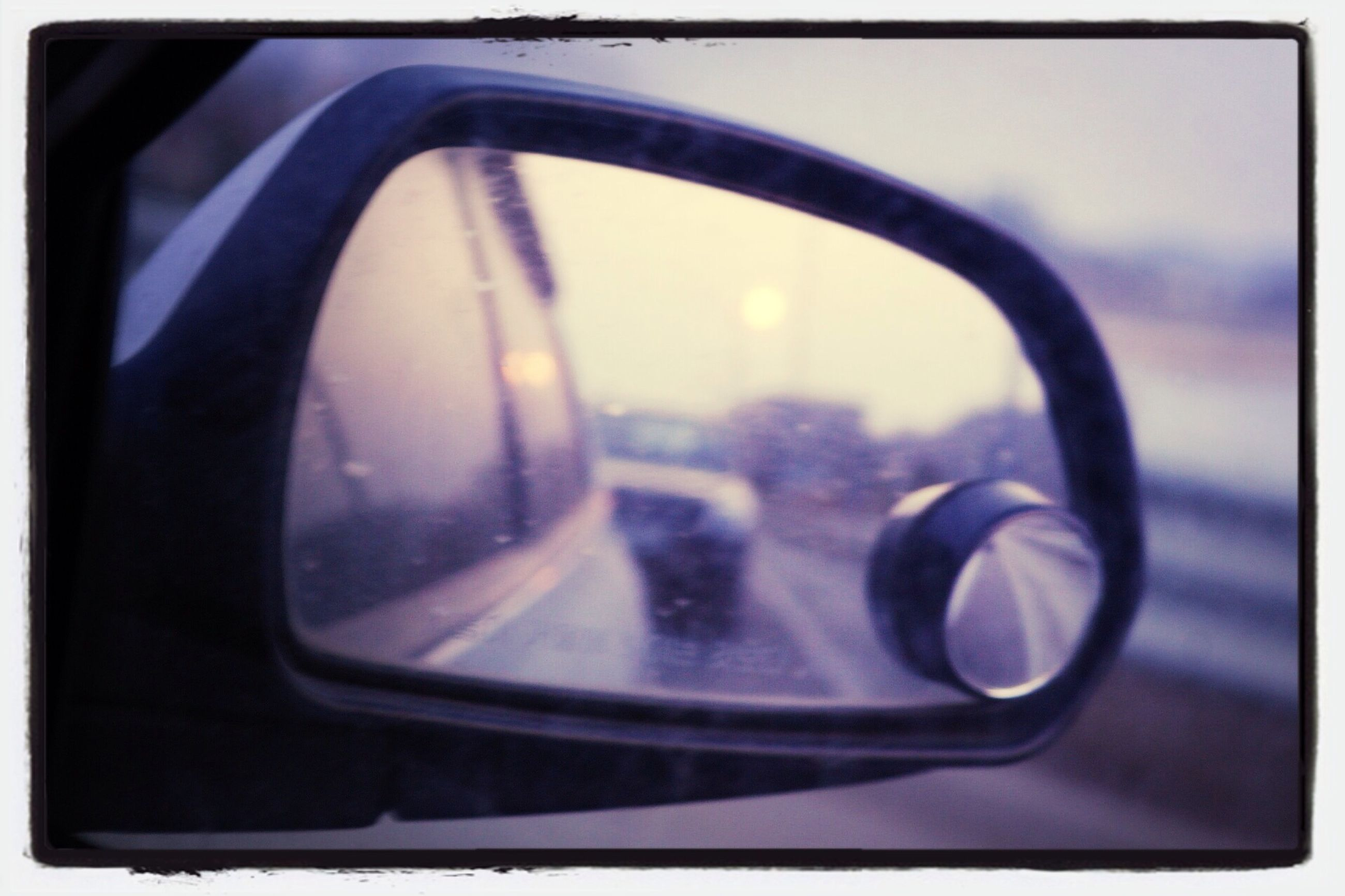 transportation, mode of transport, land vehicle, car, transfer print, side-view mirror, vehicle interior, reflection, auto post production filter, close-up, car interior, glass - material, part of, travel, transparent, focus on foreground, window, steering wheel, on the move, stationary