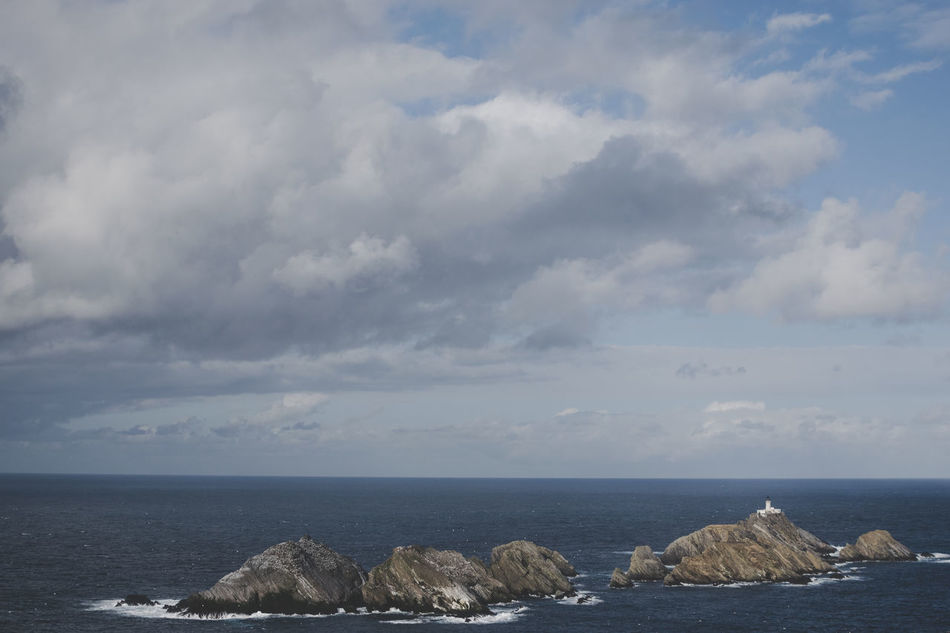 The lighthouse on Muckle Flugga, Unst Island Beauty In Nature Horizon Over Water Island Island Life Lighthouse Nature No People Outdoors Remote Rocks Scenery Scenics Sea Seascape Tranquility Water