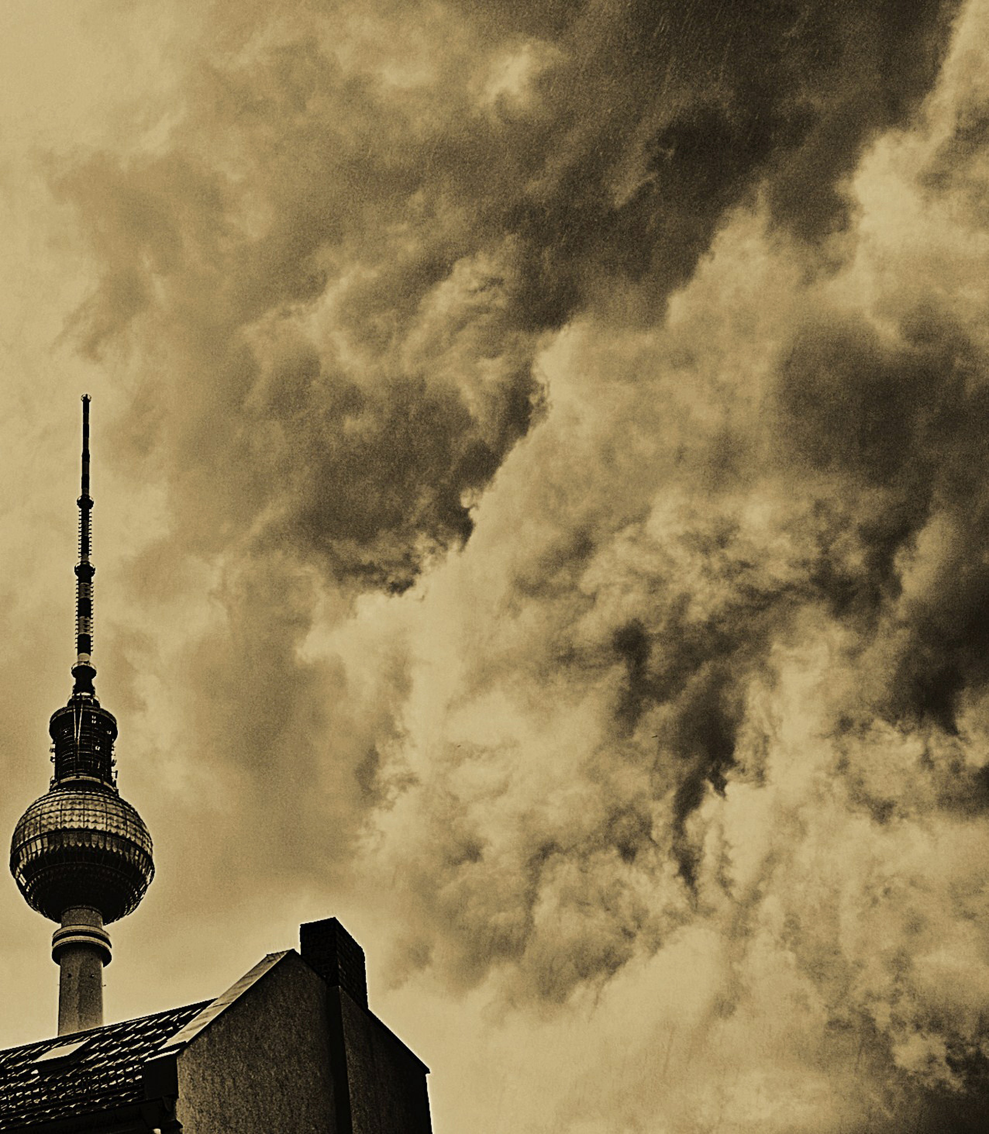 building exterior, architecture, built structure, tower, communications tower, tall - high, city, sky, communication, spire, capital cities, low angle view, famous place, international landmark, travel destinations, cloud - sky, skyscraper, television tower, fernsehturm, tourism