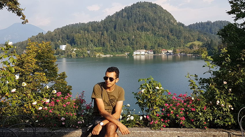 Bled Bled Castle Bled Island Bled Lake Slovenia BledCastle Castle Slovenia Adult Beauty In Nature Casual Clothing Cloud - Sky Day Flower Growth Lake Lifestyles Men Mountain Mountain Range Nature One Man Only One Person Only Men Outdoors Plant Real People Scenics Sitting Sky Tree Water Young Adult