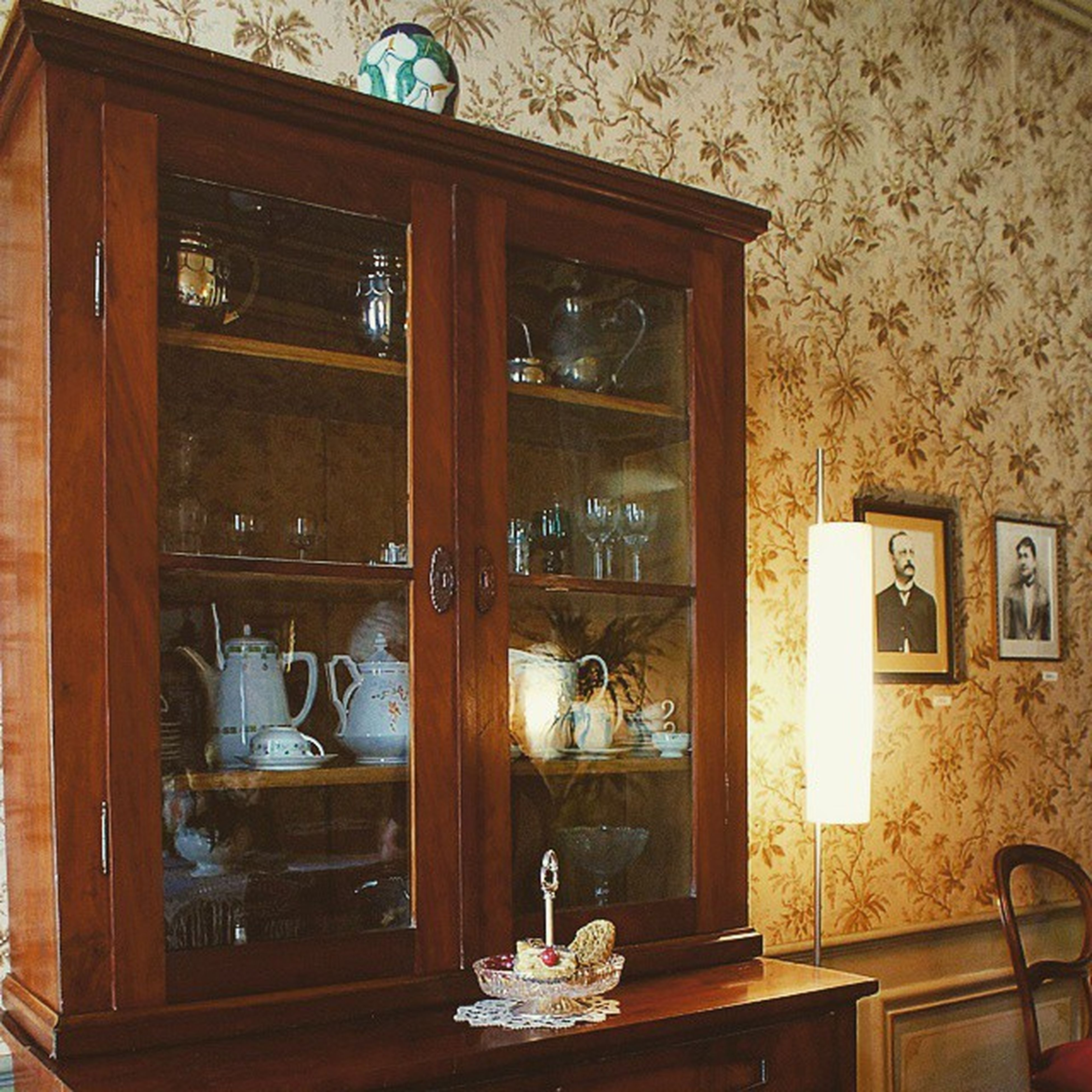 indoors, window, wood - material, glass - material, shelf, door, house, old, home interior, transparent, table, built structure, no people, architecture, old-fashioned, still life, closed, reflection, wooden, curtain