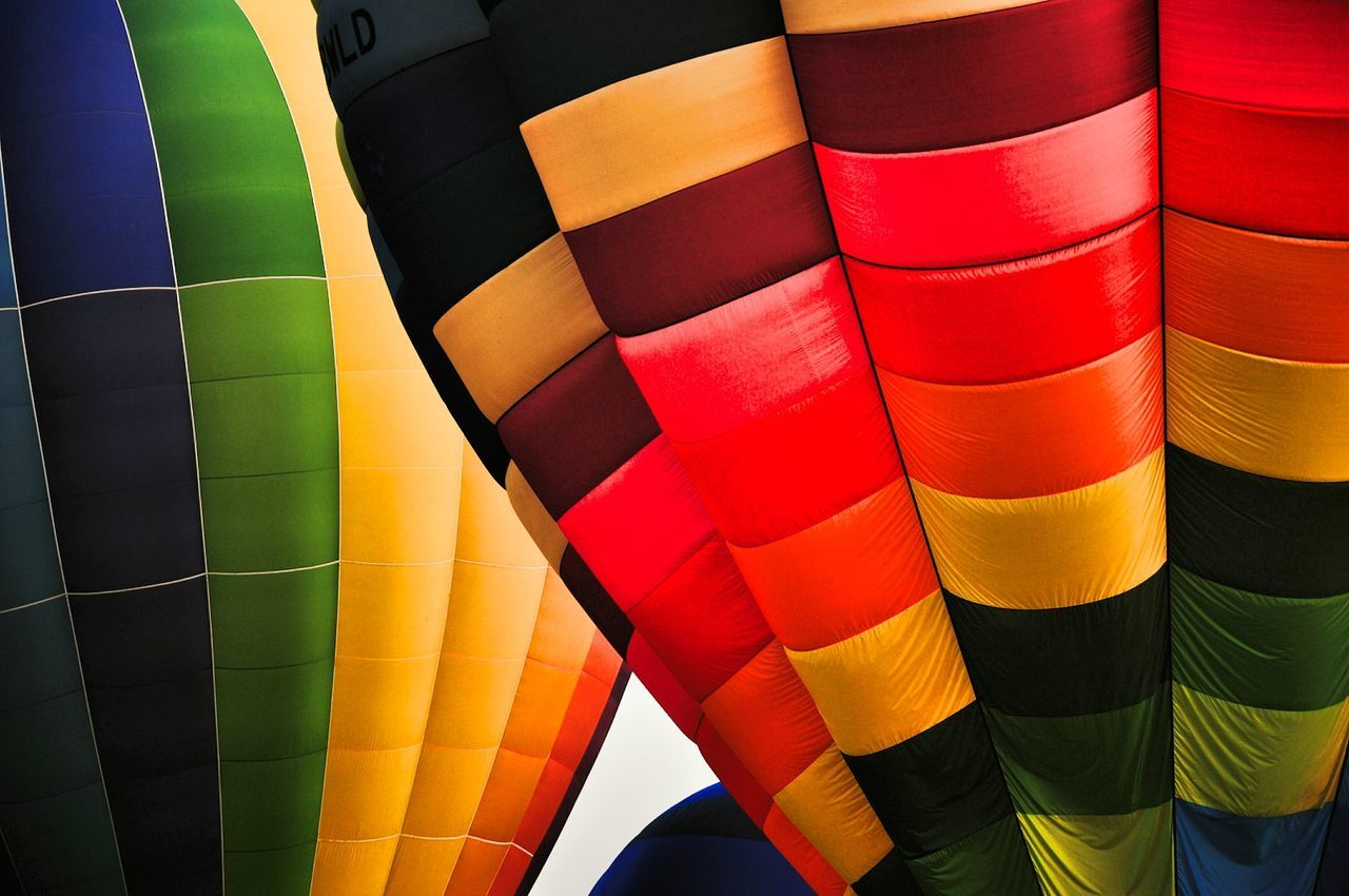 Multi Colored Adventure Hot Air Balloon Transportation Full Frame Backgrounds No People Close-up Aerospace Industry Outdoors Day Balloons Blue Sky Colorsplash Colors