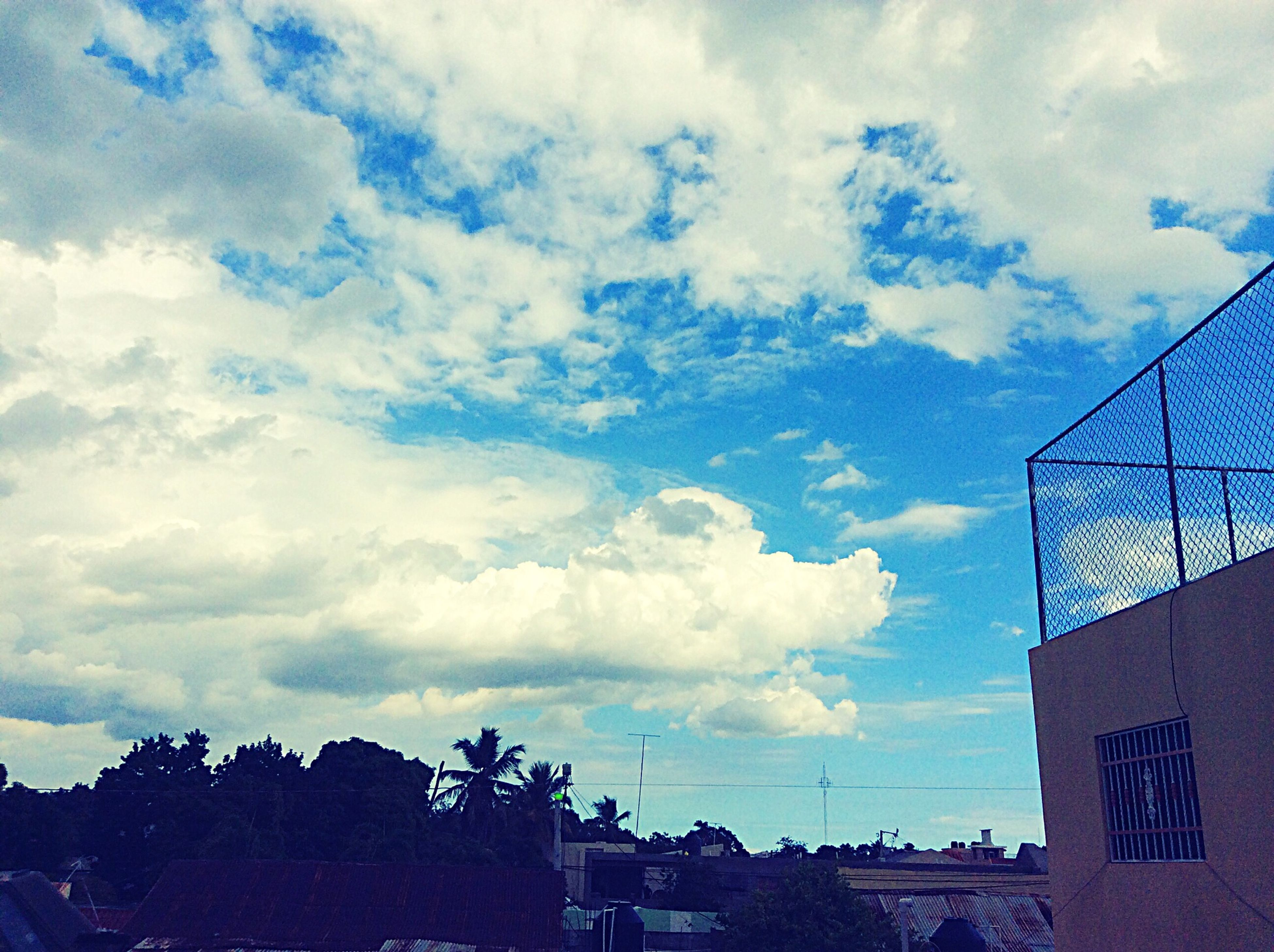 sky, building exterior, architecture, built structure, cloud - sky, low angle view, cloudy, cloud, building, city, day, outdoors, residential structure, house, residential building, no people, weather, nature, blue, sunlight