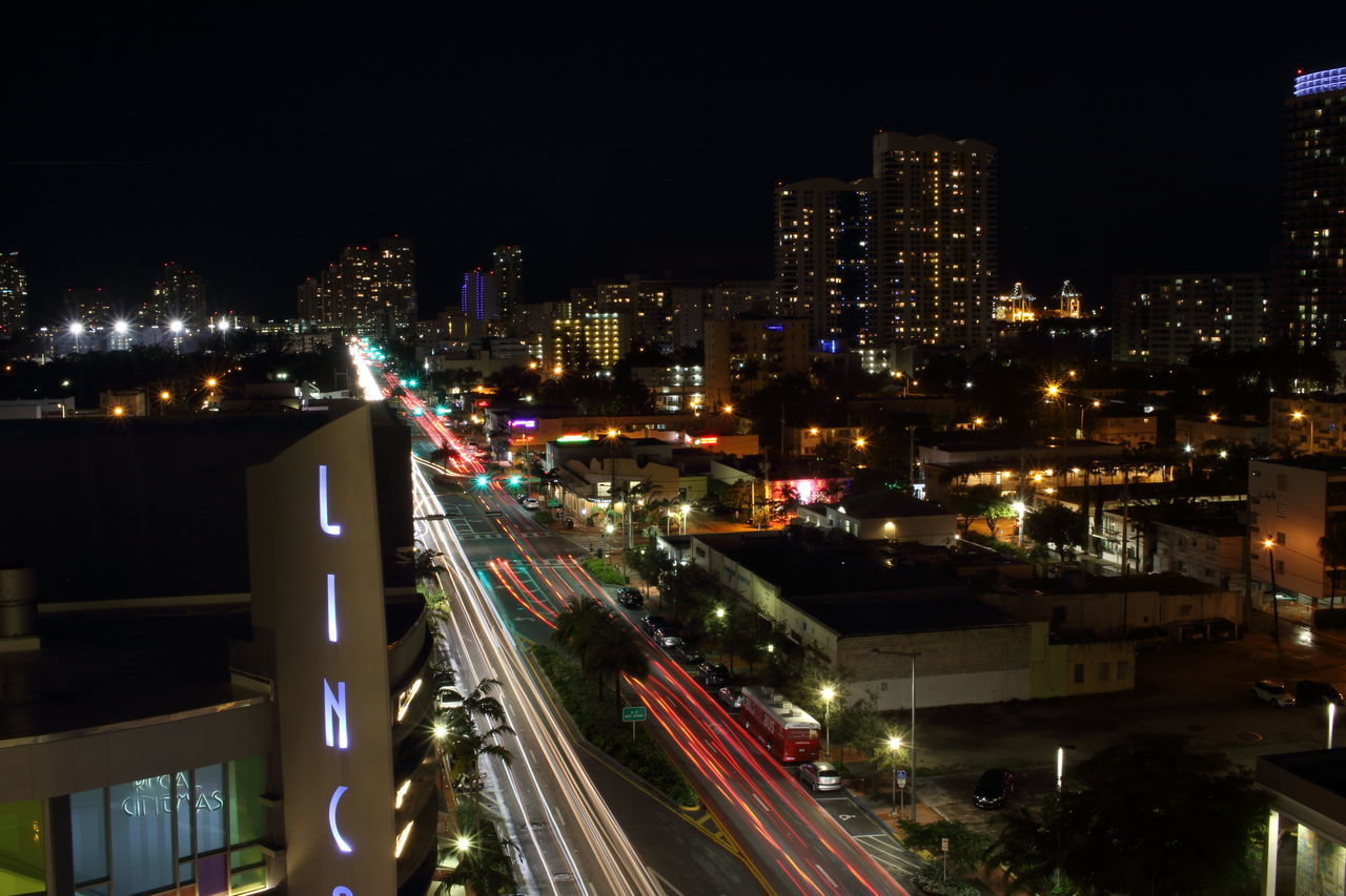 illuminated, night, speed, light trail, architecture, city, transportation, building exterior, motion, high angle view, built structure, no people, high street, long exposure, cityscape, road, outdoors, urban scene, sky