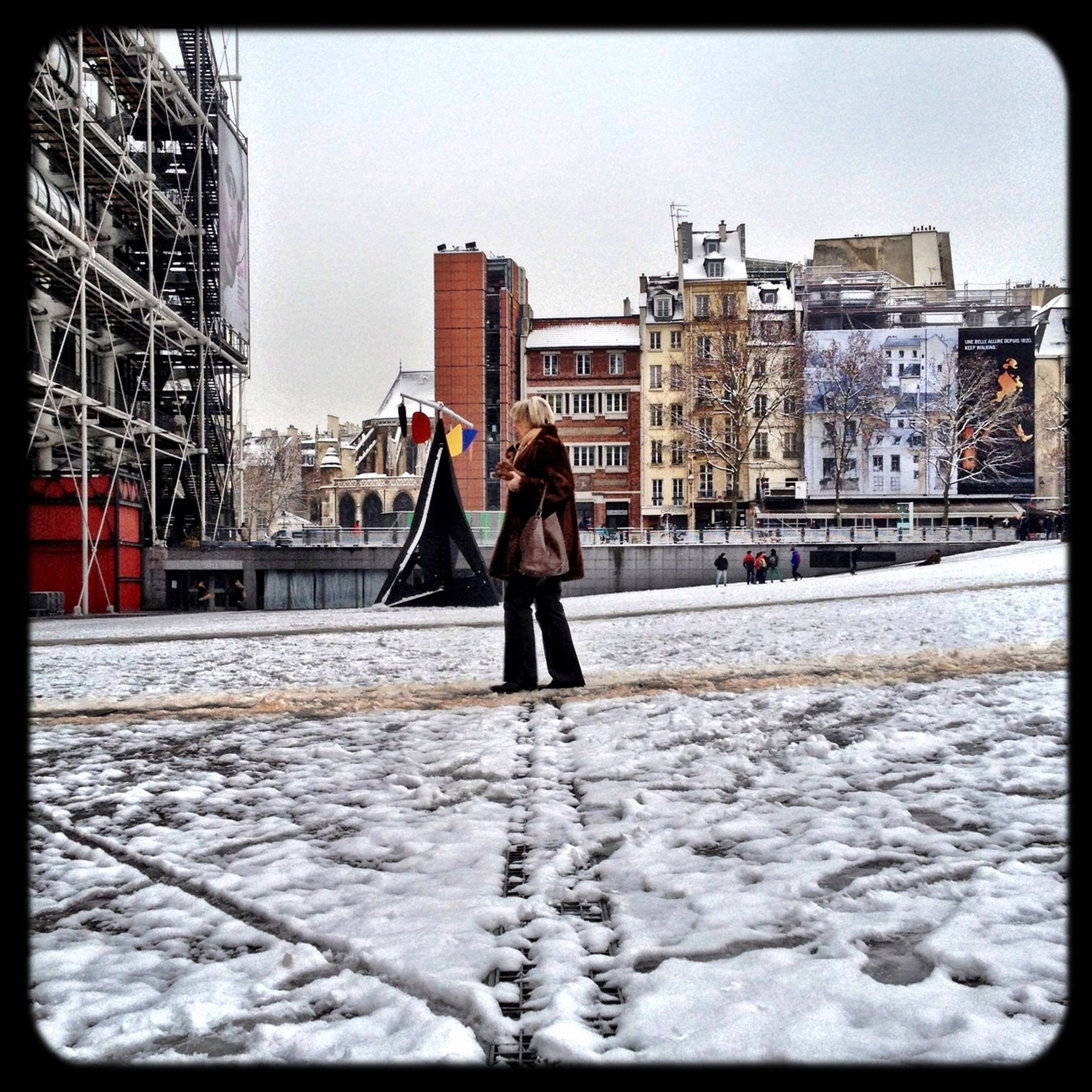 transfer print, snow, winter, full length, building exterior, architecture, cold temperature, lifestyles, built structure, season, leisure activity, auto post production filter, rear view, city, walking, warm clothing, standing, weather