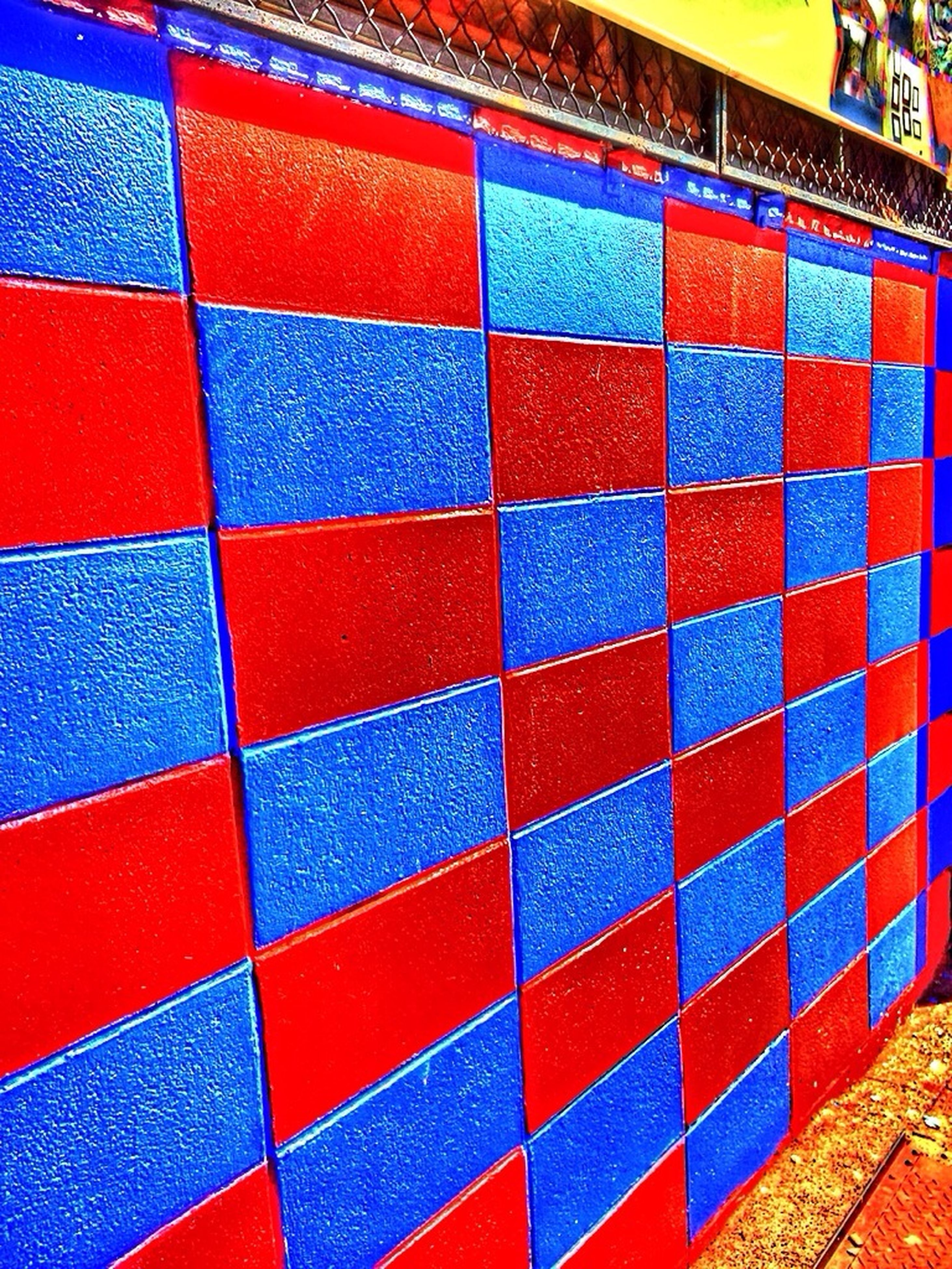 multi colored, full frame, backgrounds, pattern, red, colorful, in a row, wall - building feature, indoors, textured, repetition, variation, design, no people, close-up, large group of objects, abundance, built structure, side by side, blue