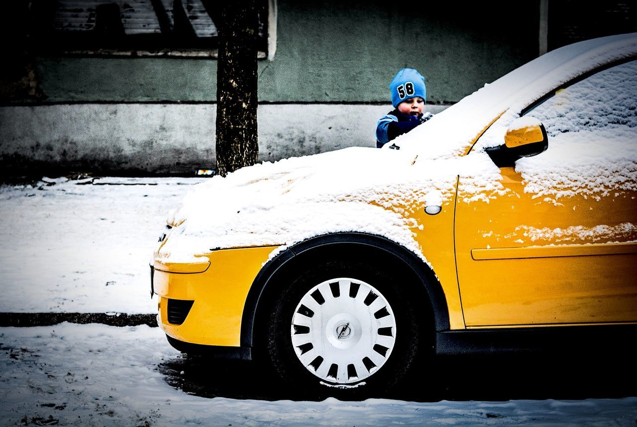 transportation, yellow, land vehicle, mode of transport, real people, one person, car, outdoors, day, cold temperature, winter, helmet, full length, men, snow, headwear, people