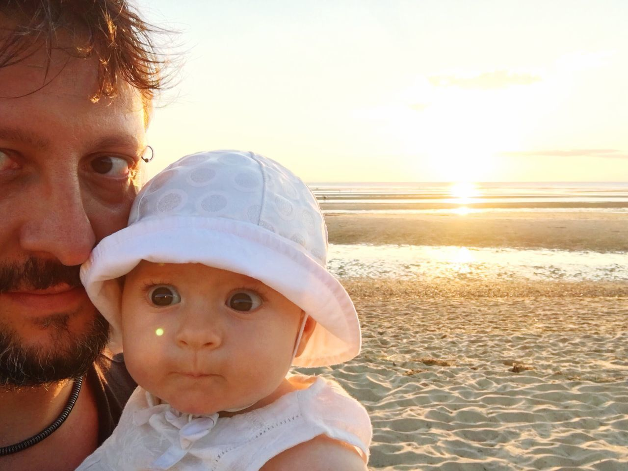 Man And Baby On Beach At Sunset