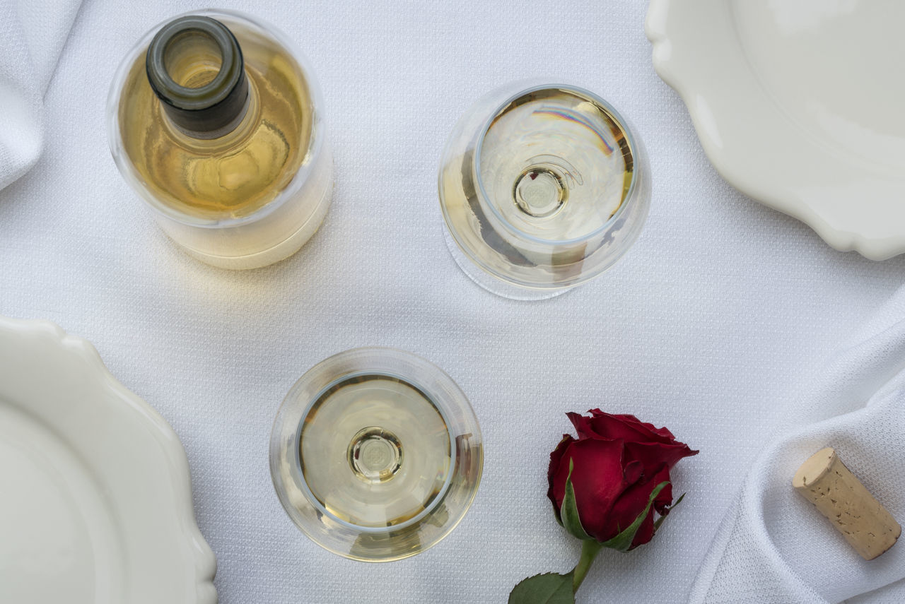 2 glasses of white wine, bottle, rose, cork on white linen table setting Alcohol Alcohol Bottles Beauty In Nature Beverage Check This Out Close-up Drinking Glass Flowers High Angle View No People Sophisticated Sophisticated Adult Stemware Two Valentine's Day  White Wine