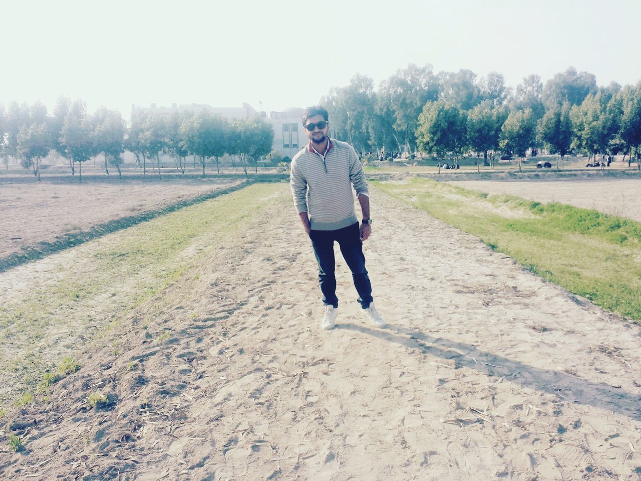 Full Length Of Man Standing On Field Against Sky During Sunny Day