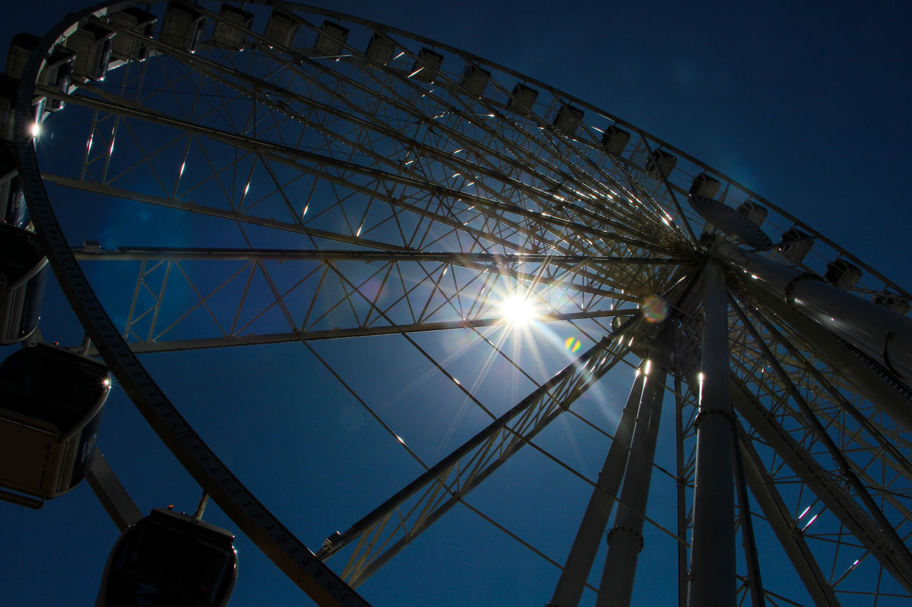 Amusement Park Amusement Park Ride Arts Culture And Entertainment Big Wheel Blue Built Structure Clear Sky Day Ferris Wheel Ferry Wheel Low Angle View No People Outdoors Sky Sun Sunlight BYOPaper! The Great Outdoors - 2017 EyeEm Awards