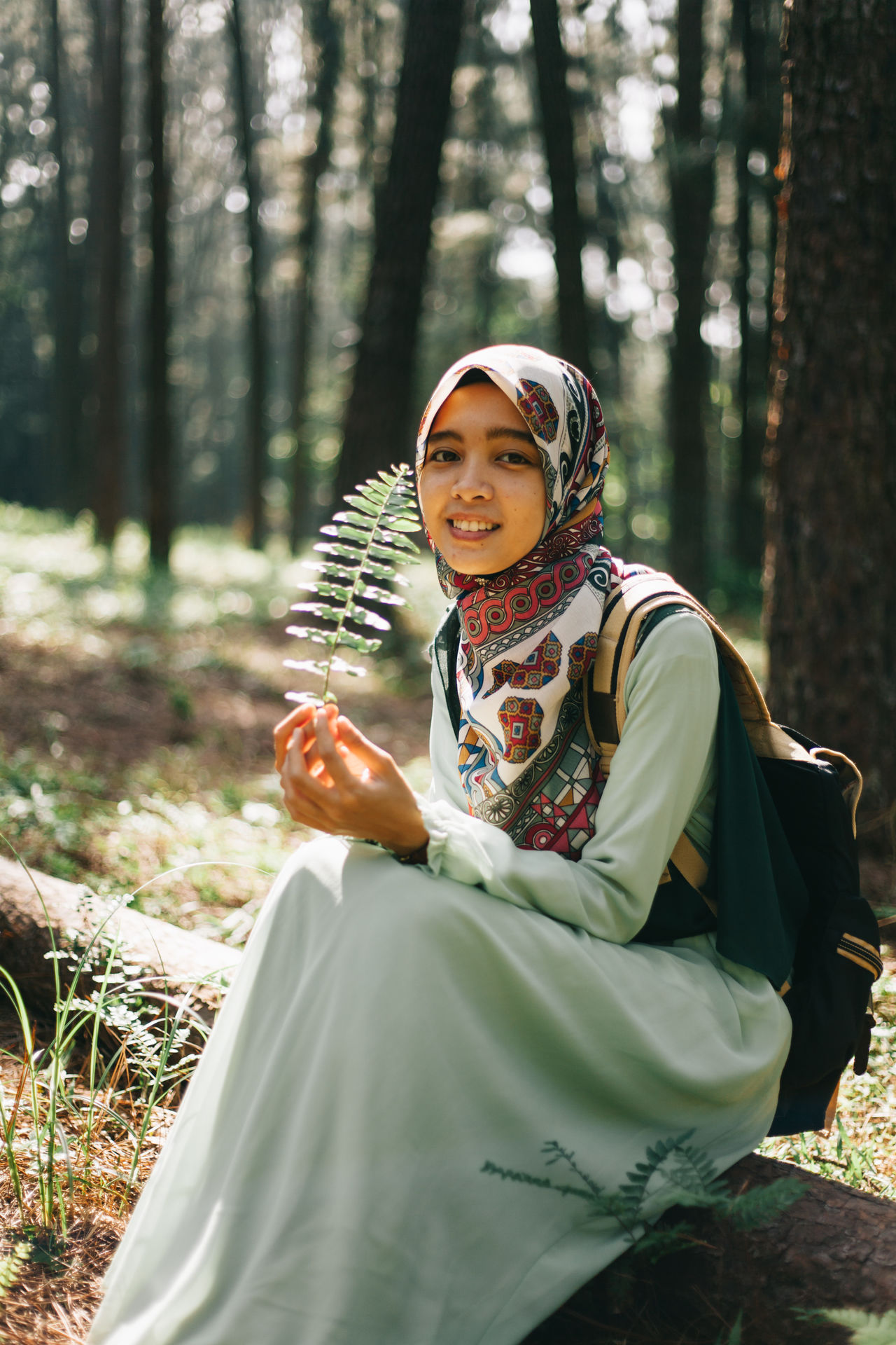 Beautiful women holding a leave. Beautiful women sitting on a tree. Beautiful women are looking for something. Adult Beautiful Nature Beautiful People Beauty Beauty In Nature Fashion Forest Girl Lanscape Leaves Nature Outdoors People Pine Portrait Portrait Of A Woman Smiling Travel Travelling Tree Walking Women Young Women