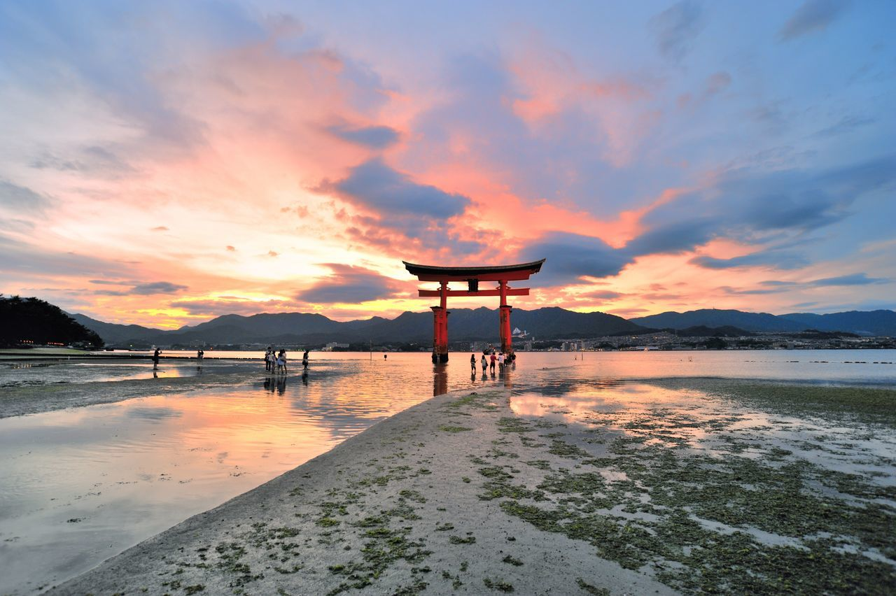 A glorious sunset on the Island of Itsukushima (also known as Miyajima). To experience Miyajima, you should stay in the island at least one night as the island seems transformed to something magical when most of the tourists have gone back to the main island. Architecture Beauty In Nature Built Structure Cloud - Sky Hiroshima Itsukushima Japan Japan Photography Miyajima Miyajima Torii Nature Outdoors Scenics Sea Silhouette Sky Sunset Sunset_collection Tranquil Scene Tranquility Water Neighborhood Map