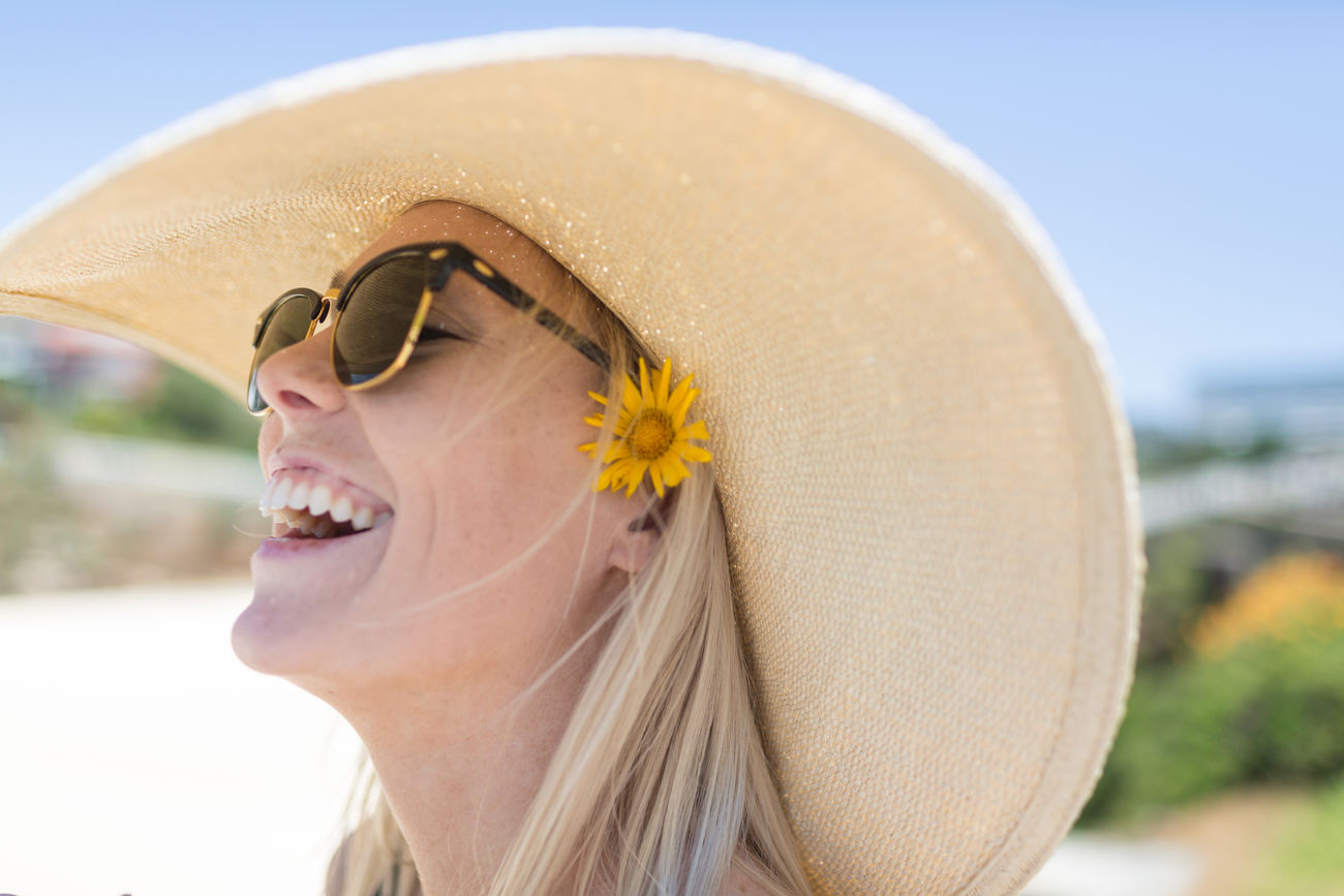 Adult Adults Only Beach Close-up Day Girllaughing Hat Laughing Out Loud Lifestyles Mature Adult One Person One Woman Only Only Women Outdoors People Rural Scene Sand Sky Sunglasses Sunlight TheWeekOnEyeEM Tradition