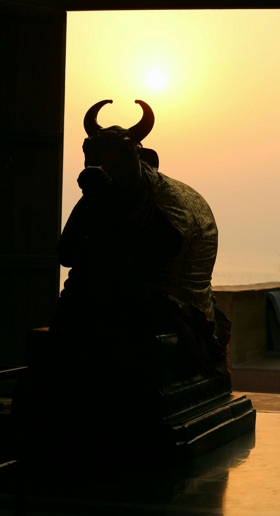 Silhouette of Nandi : In Hindu Religion , Nandi , नन्दि, , நந்தி, ನಂದಿ, న౦ది,  ନନ୍ଦି‎‎) is the name for the bull which serves as the mount of the Lord Shiva and as the gatekeeper of Shiva and Parvati. Nandi Bull Silhouette Nandhi Shivan OmNamahShivaya Hinduism Hindu Temple Hindu Gods Hindu Culture India Indian Culture  EyeEm Best Shots EyeEm Eyeem India INDIAN TRADITION Gujarat Gujarattourism Photographic Memory Travel Travel Diaries Incredible India