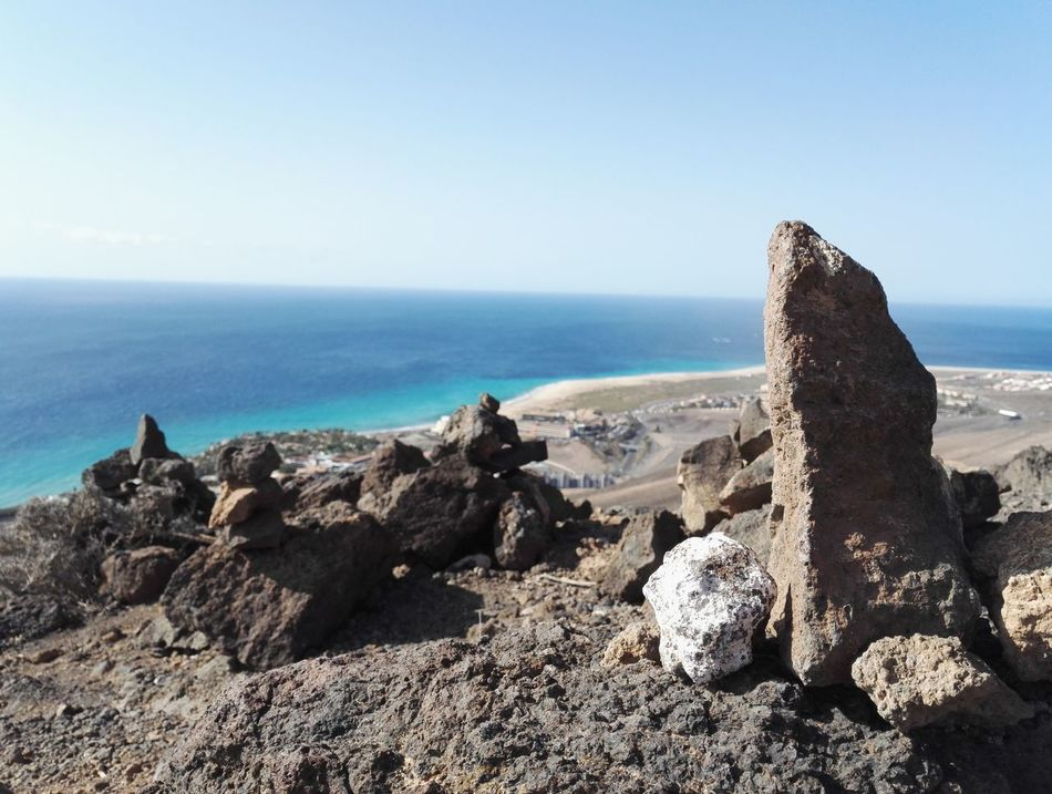 Sea Rock - Object Beach Nature Outdoors Tranquil Scene Beauty In Nature Scenics Day Horizon Over Water No People Sky Mountains Fuerteventura SPAIN Clear Sky Wild Nature Hilltop Desert Wasteland Beauty In Nature Tranquility Landscape Nature Vacation