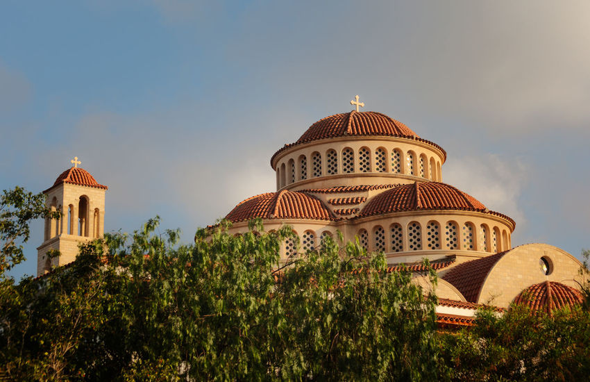 Modern Greek Orthodox Church built in the traditional style. Architecture Building Exterior Built Structure Day Dome Foreground Foliage Greek Orthodox Cathedral Light Clouds No People Outdoors Place Of Worship Religion Sky Spirituality Tower Traditional Construction Travel Destinations