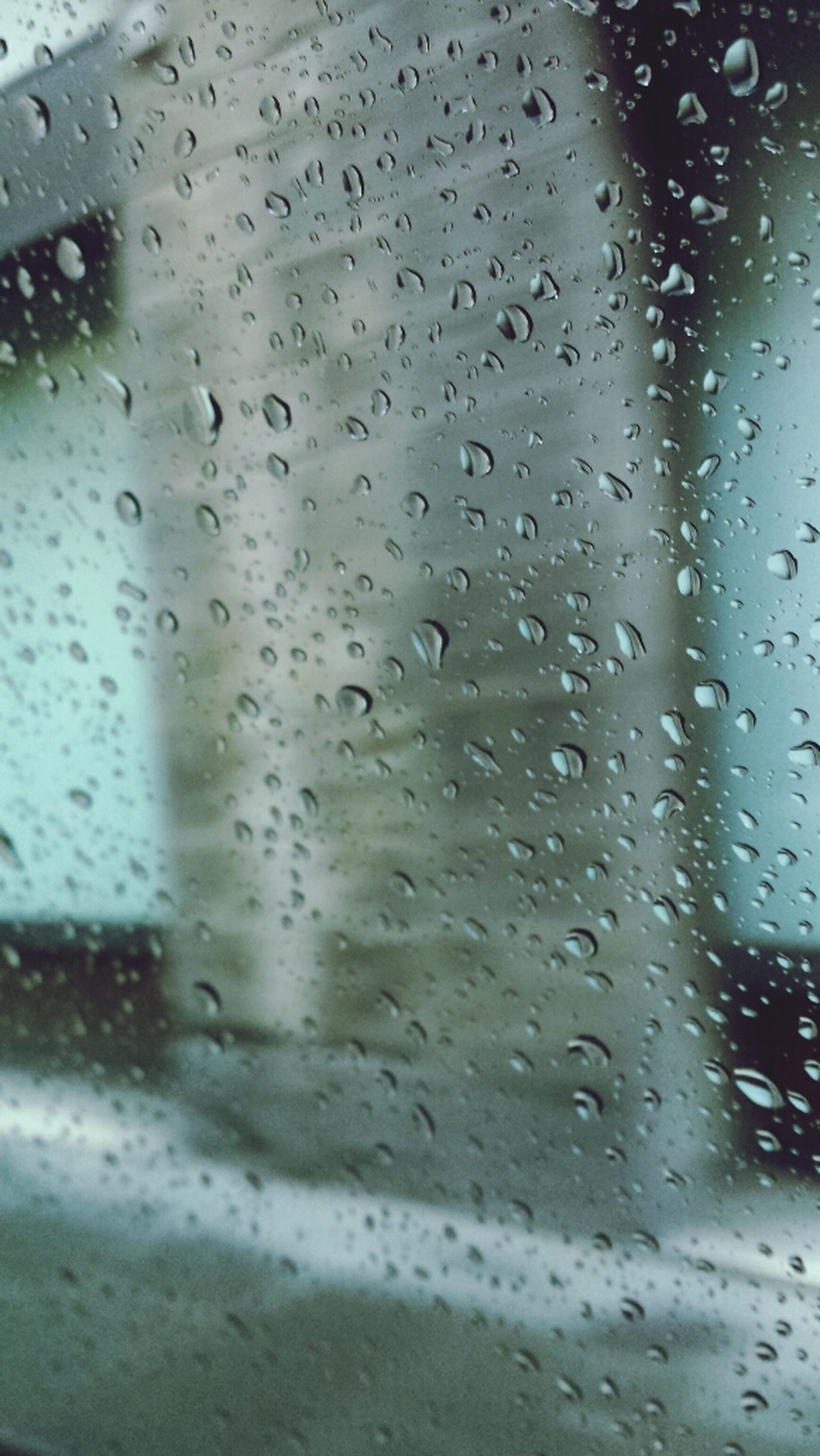 drop, wet, window, rain, glass - material, transparent, water, indoors, raindrop, season, weather, full frame, close-up, car, backgrounds, glass, transportation, vehicle interior, focus on foreground, land vehicle