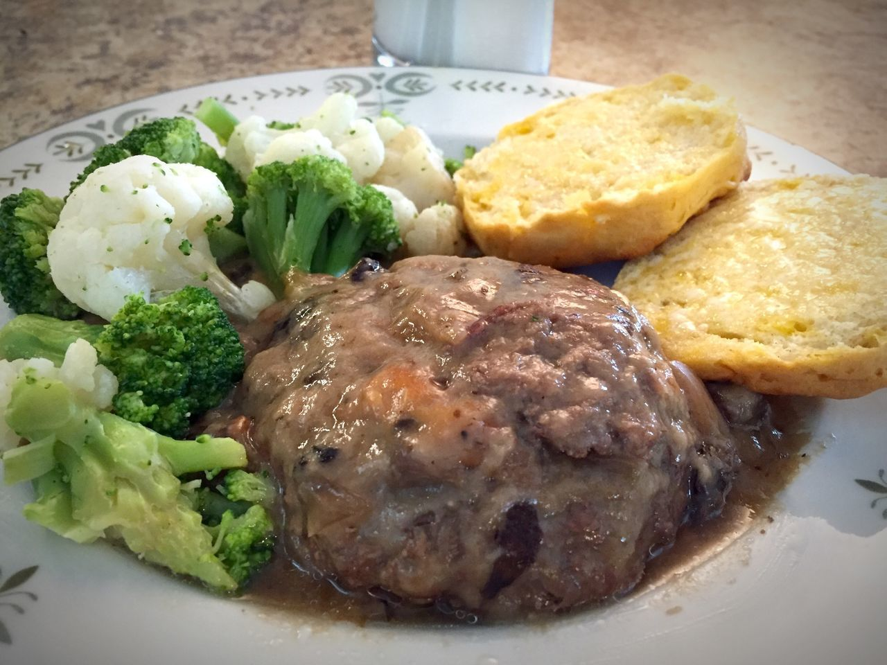 Hamburger steak with mushroom gravy and a side of broccoli & cauliflower. Biscuits Broccoli Cauliflower Close-up Dinner Food Freshness Hamburger Hamburger Steak Indulgence Lunch Meal Meat Mushroom Gravy No People Plate Ready-to-eat Served Serving Size Still Life Sunset Temptation