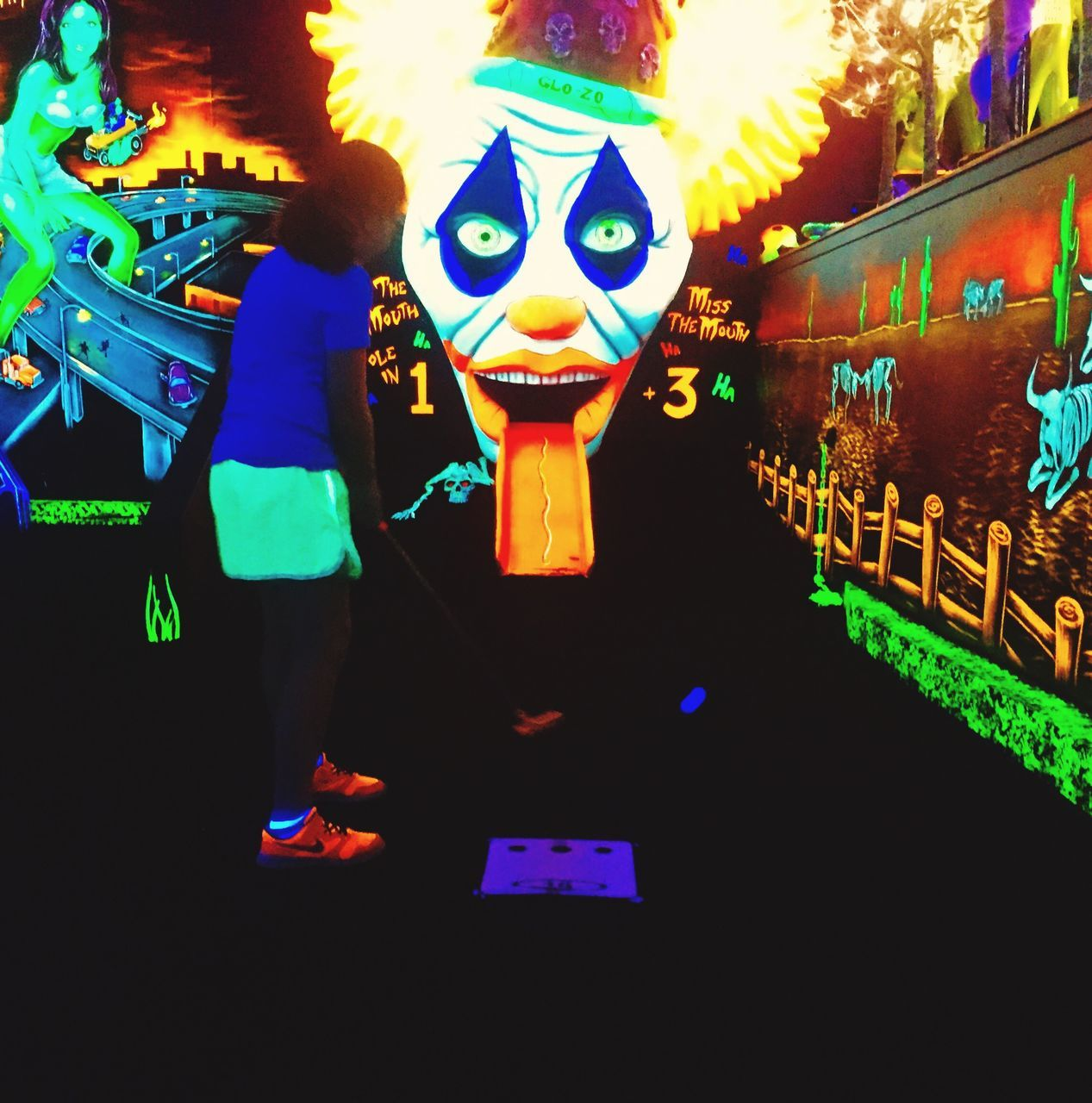 multi colored, night, one person, carnival, real people, illuminated, standing, celebration, indoors, childhood, close-up, people