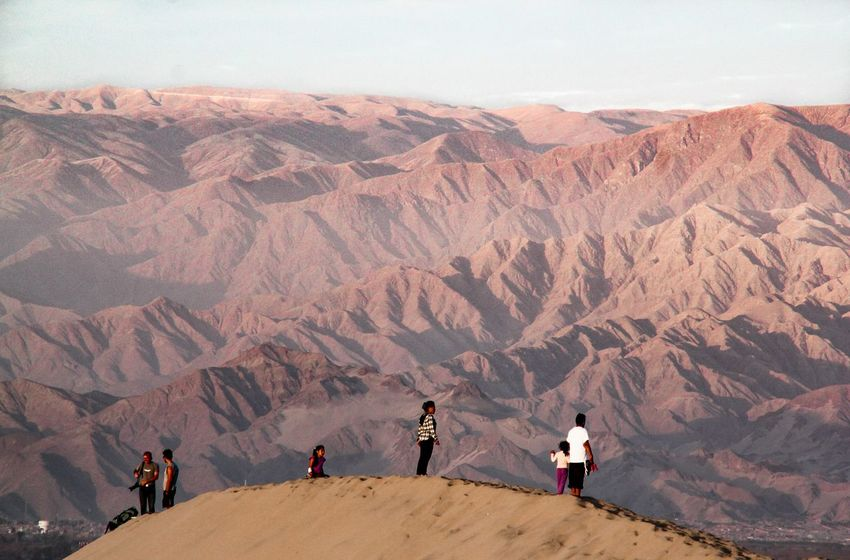 Feeling the badlands EyeEm Selects Hiking Mountain Desert People Walking Adventure Adult Landscape Outdoors Travel Destinations Mountain Range Vacations Nature Sand Dune Dunas Dunes Huacachina Peru Peruvian Ica Desert Oasis Sunset Badlands