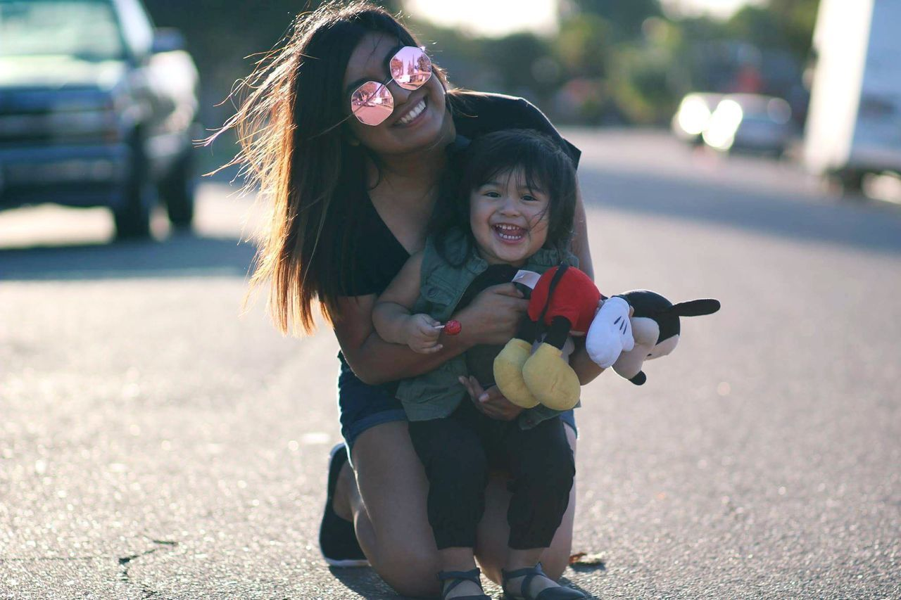 real people, family with one child, togetherness, love, mother, childhood, family, bonding, daughter, smiling, happiness, lifestyles, full length, outdoors, day, portrait, young women, young adult, people