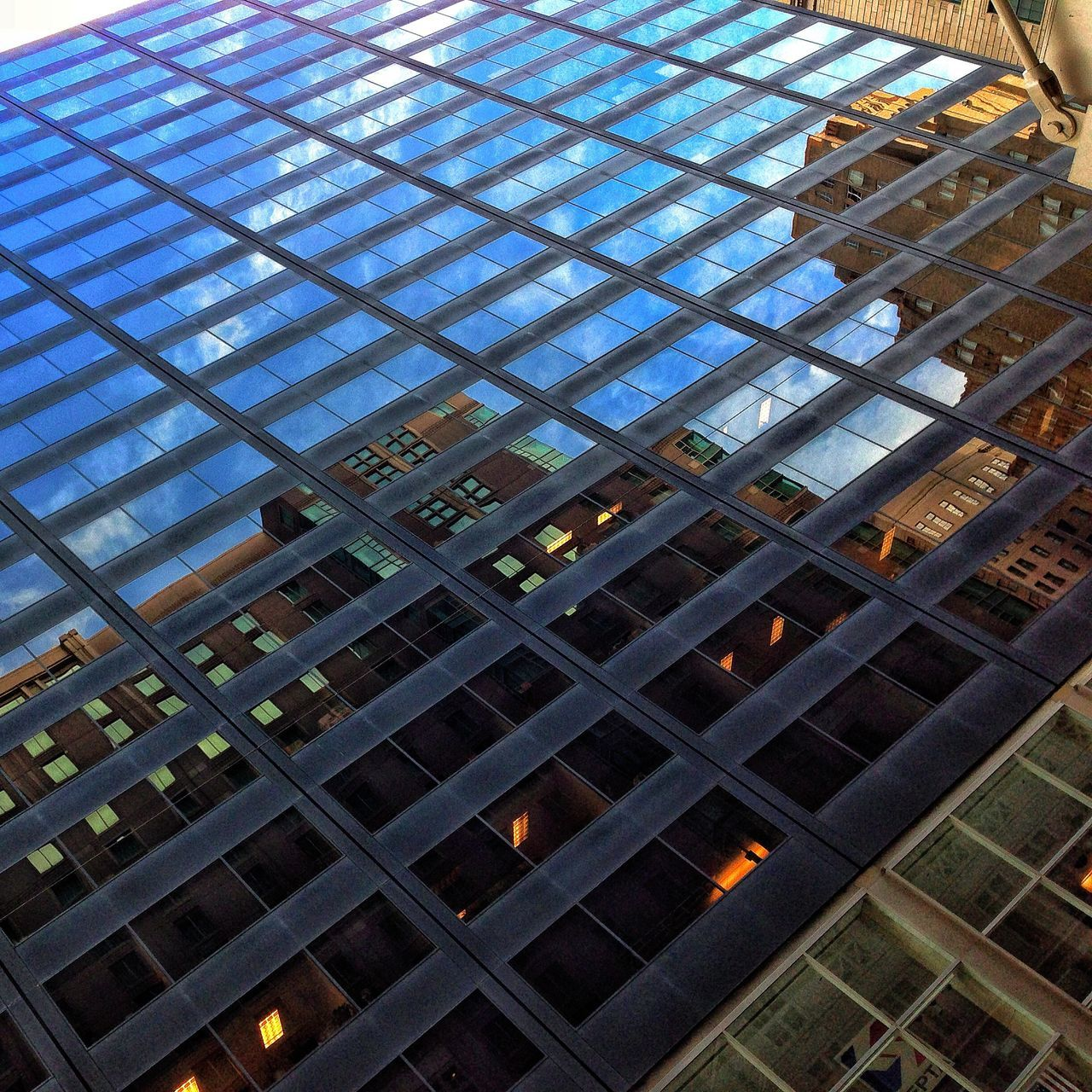 architecture, built structure, low angle view, building exterior, window, day, reflection, modern, indoors, no people, skyscraper, city, sky