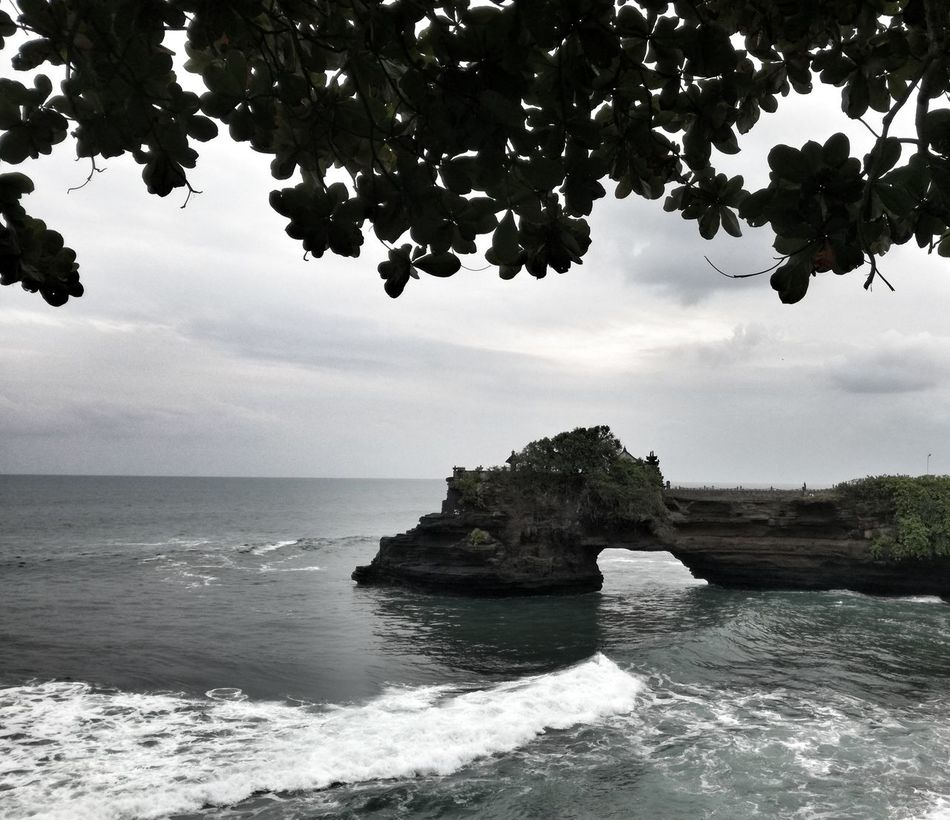 Sea Nature Scenics Water Tree Beauty In Nature Rock - Object Beach Tranquility Outdoors Horizon Over Water Tranquil Scene Landscape No People Cloud - Sky Day Sky EyeEm Selects Tropical Climate Extreme Weather Travel Destinations Pacific Islands Beauty In Nature Bali Leisure Activity
