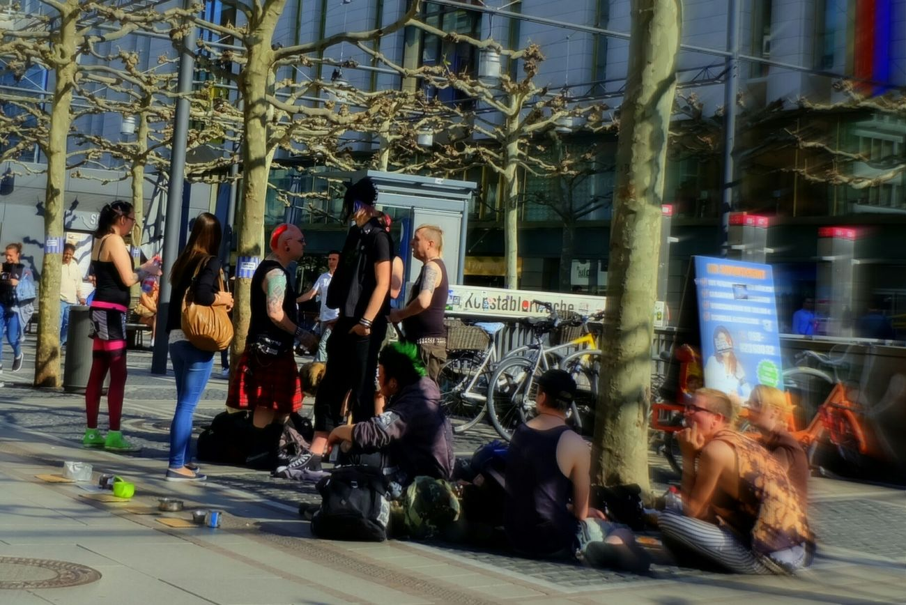 Some things never change : punks chillin in the pedestrian area. PUNK IS NOT DEAD! 😈 Punks Punksnotdead Hanging Out Taking Photos City Life Everyday Lives Peopleinthecity FrEaKs Alternativefashion Streetlife