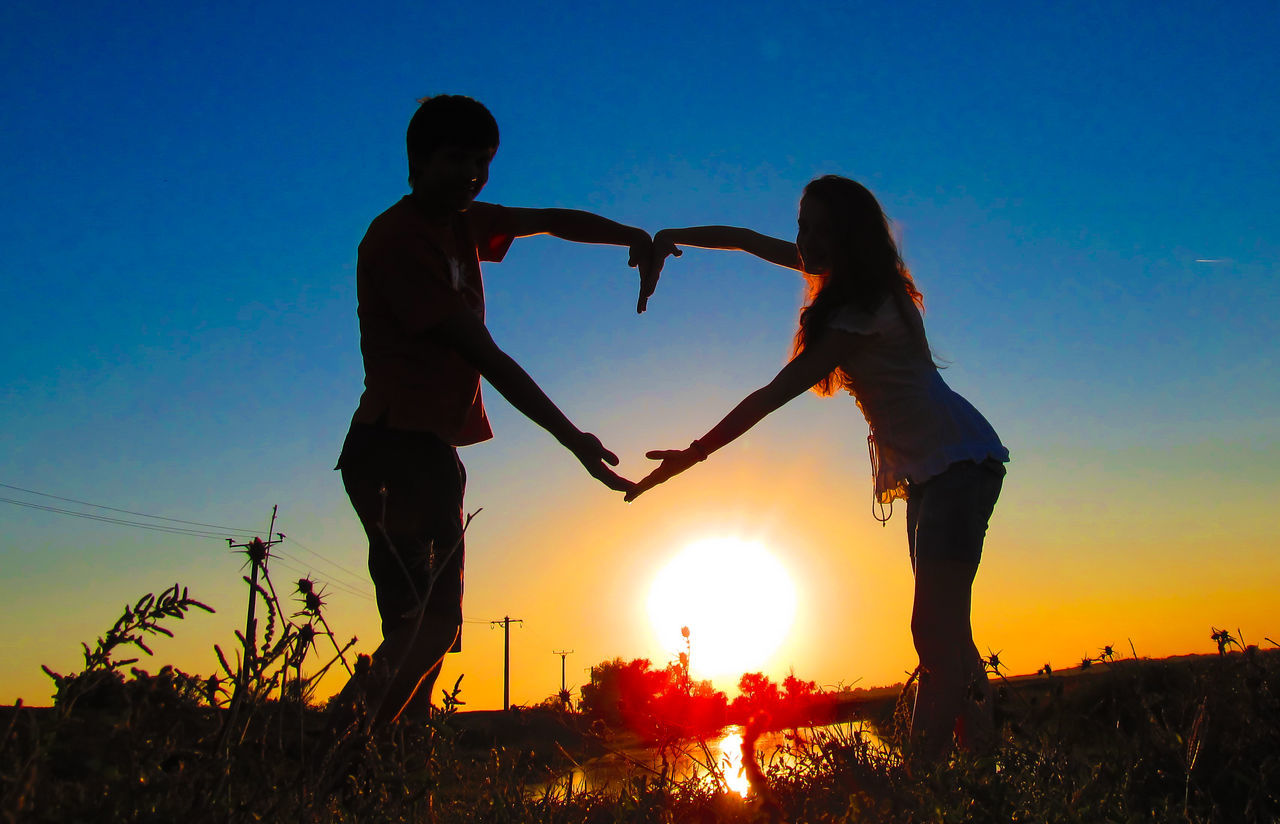 Adult Adults Only Friendship Heart Shape Human Body Part Human Hand Lifestyles Love Men Nature Outdoors People Real People Romania Silhouette Sky Sun Sunset Togetherness Touching Two People Unity
