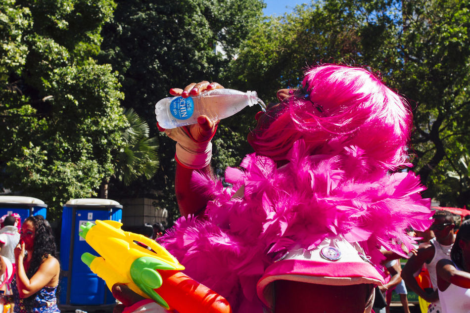 Carnival Carnival Fantasy Carnival Spirit Colors Of Carnival Cultures Drinking Water Enjoyment Focus On Foreground Front View Happiness Joy Of Life Muquiranas Party Time Pink Wig Portrait Salvador Bahia Water Gun