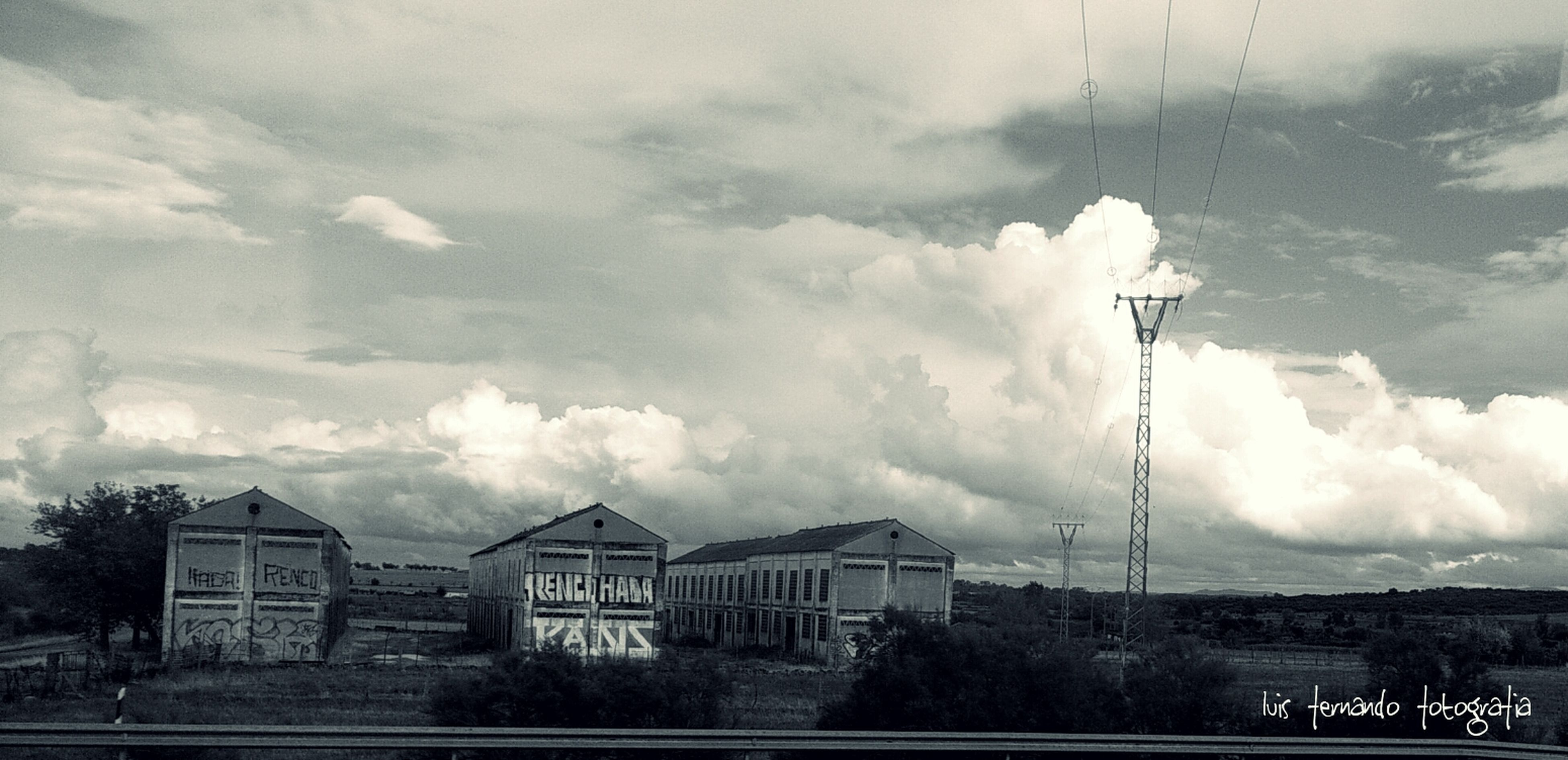 sky, cloud - sky, building exterior, cloudy, architecture, built structure, weather, cloud, overcast, field, nature, house, tree, day, landscape, road, city, outdoors, storm cloud, no people