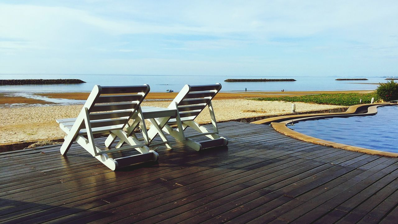 sea, beach, water, horizon over water, absence, tranquil scene, tranquility, sun lounger, shore, sky, sand, nature, scenics, no people, day, chair, summer, vacations, beauty in nature, idyllic, outdoors, sunlight, luxury