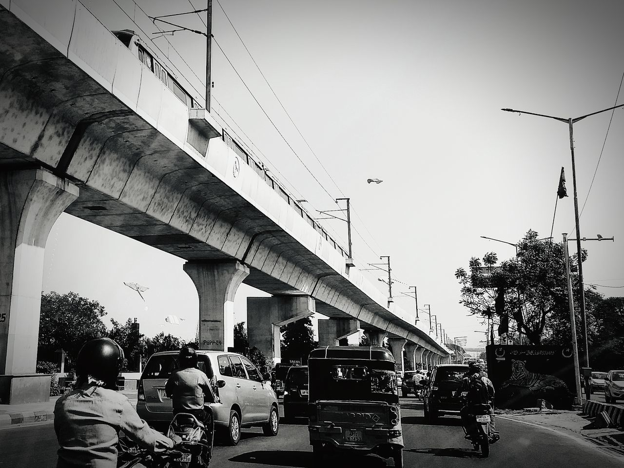 Modernity of Hyderabad metro rail in the backdrop of traditional kite flying on Sankranthi. Modernity Modern Traditional Metro Train Kite Flying Perspective Modernity & Tradition Outdoors Transportation Monochrome
