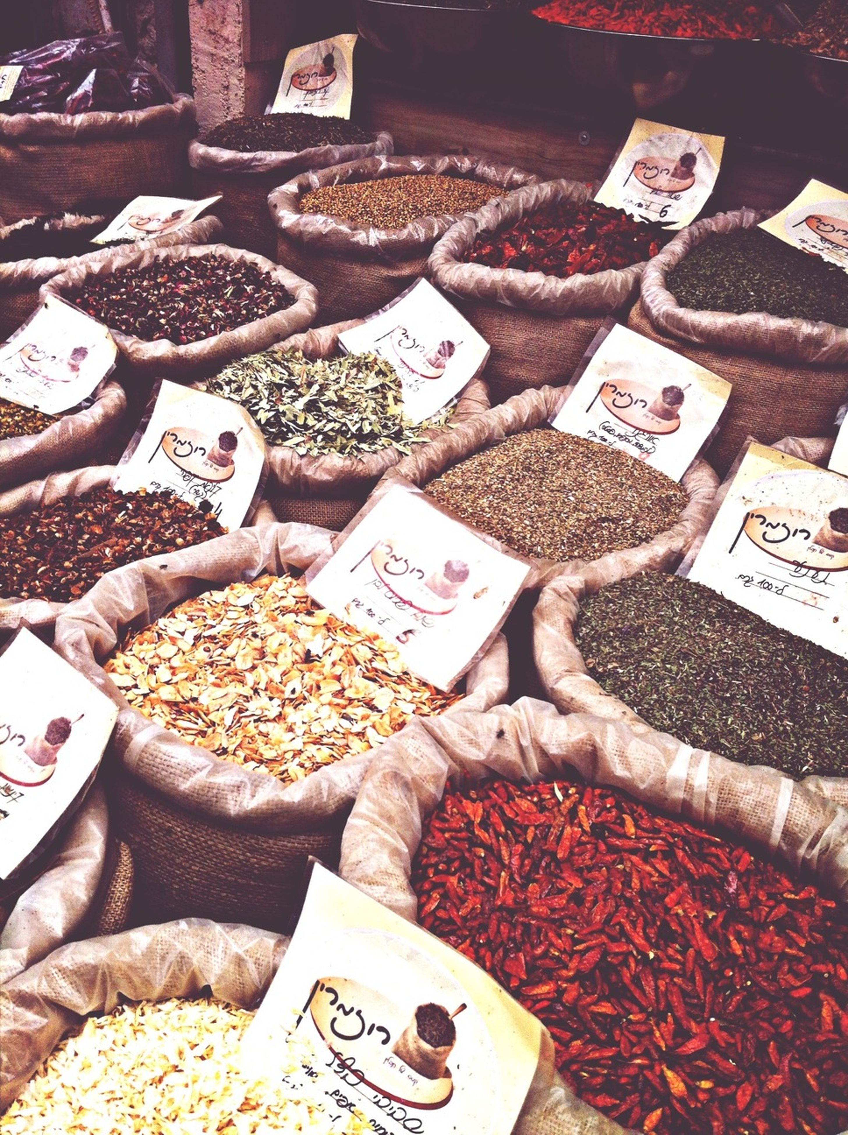 abundance, large group of objects, for sale, variation, retail, market, market stall, choice, high angle view, price tag, text, arrangement, food and drink, communication, stack, food, small business, collection, freshness