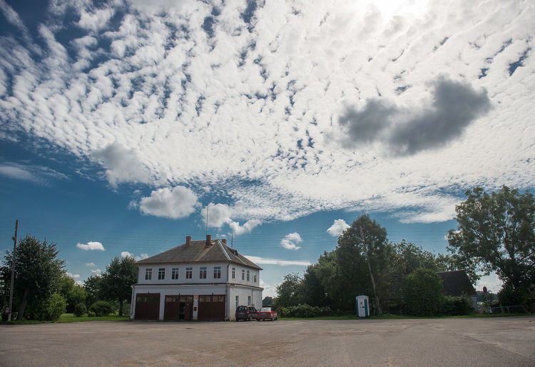 Architecture Building Exterior Cityscape Cloud - Sky Day Dramatic Sky Fire Station Landscape Latvia, In Dagda No People Old Buildings Old-fashioned Outdoors Place Sky Smoll City Tree