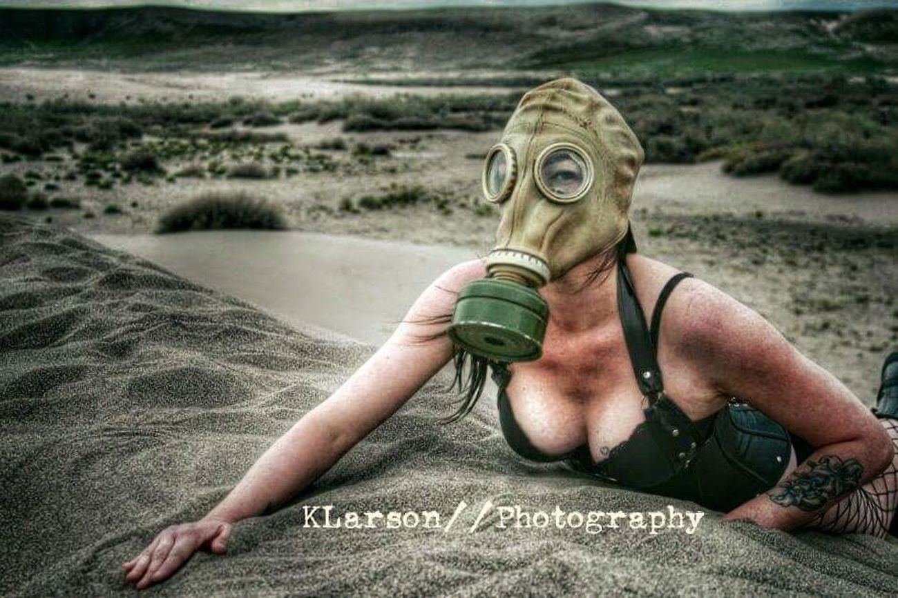 Apocolypse at the dunes One Person Outdoors Adults Only Portrait One Woman Only Women Real People Adult Only Women People Day Close-up Nature Gasmask Sand Sand Dune Peeking Laying Spying Desert EyeEmNewHere Eyeemphotography Apocalypse Dunes Tattoos