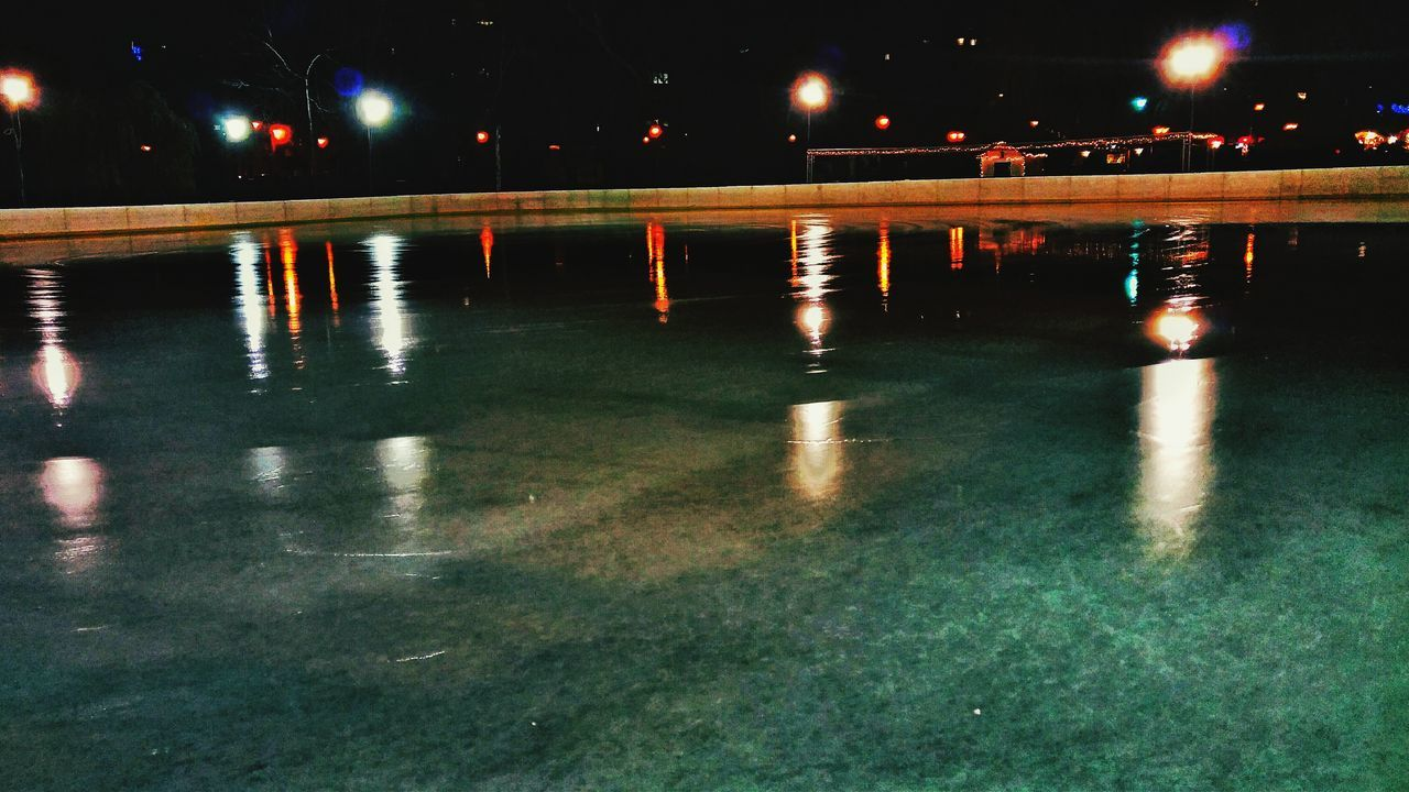 Ice skating arena in the lights of the night. Reflection Water Illuminated Wet Night Transportation Rainy Season Road Outdoors No People Nature Sky Skate Skating Skatelife Skating In The Dark Skating In Skatenoarding Park Wintertime Frozen Frozen Lake