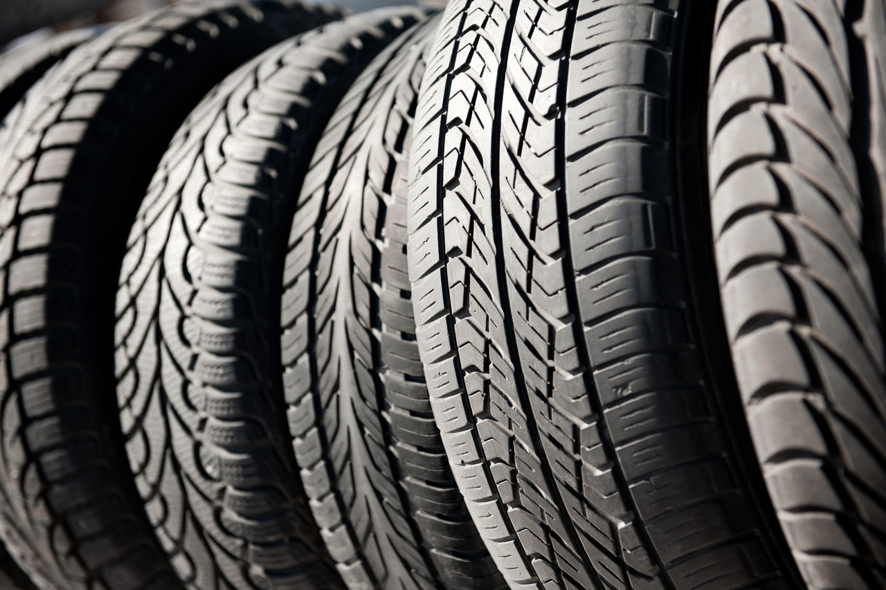 Group of used black tires in row, old objects detail in open air, horizontal orientation, nobody. Black Close-up Covering Few Group Industry No People Old Row Rubber Tire Tires Tyre Tyres Used Wheel