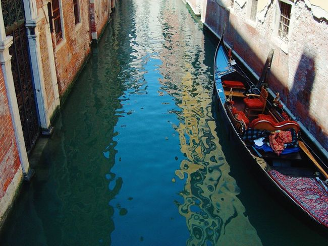 Secret Venice, canal and gondola between shadows and sunlight, for a poetic journey Canal Water Transportation High Angle View Gondola Architecture Gondola - Traditional Boat No People Day Venice, Italy Venezia Venice Canals Perspective Sunny Day Romantic Travel Destinations Travel Urban Landscape Traveling Journey Mode Of Transport Outdoors Cityscape Wall Shadows