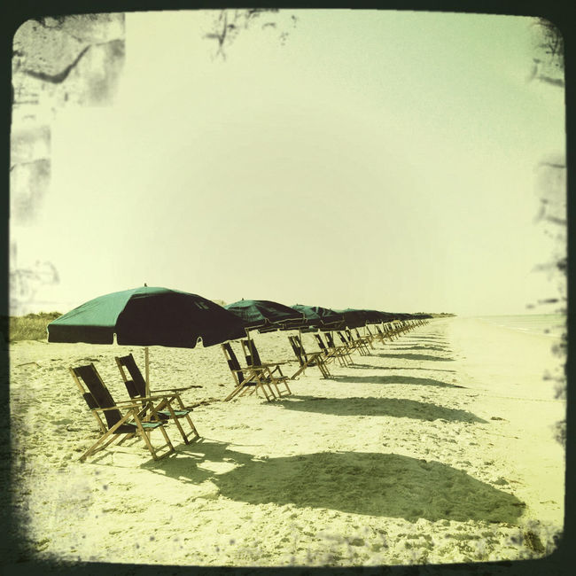 The Calm Before The Storm Beach Blue Umbrellas Caledesi Island Float Film Florida Florida Life Hipstamatic Hipstography Outdoors Sand Shadows Shadows And Sunlight Shore Tranquility Umbrellas Vacations IPhoneography IPS2016StillLiife