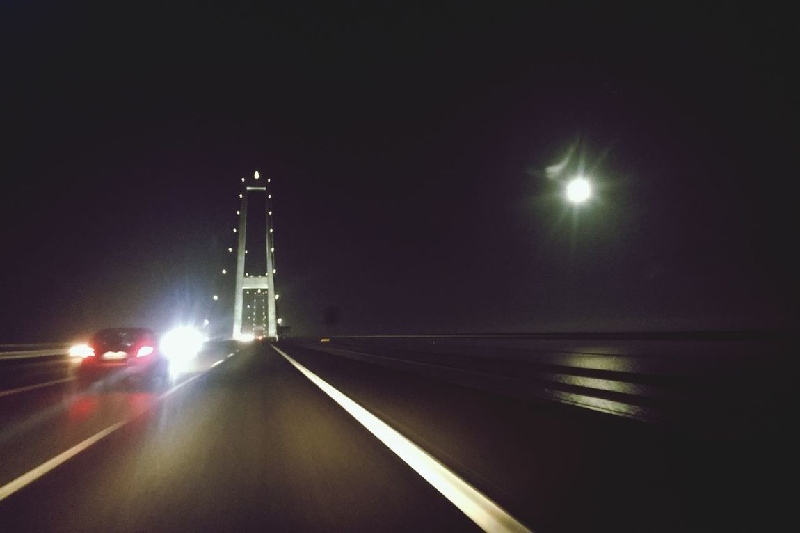Denmark 🇩🇰🇩🇰🇩🇰 Big Belt Bridge Morning Moon In The Horizon Bridge - Man Made Structure 234 Mtr Stil Dark Cars On The Road!! Cars On The Bridge Illuminating Light Transportation Road Outdoors Most Wonderful Time Of The Year! Fine Art Photography ☀️HAPPY CHRISTMAS TO ALL OFF YOU On The Road On The Move Illuminated