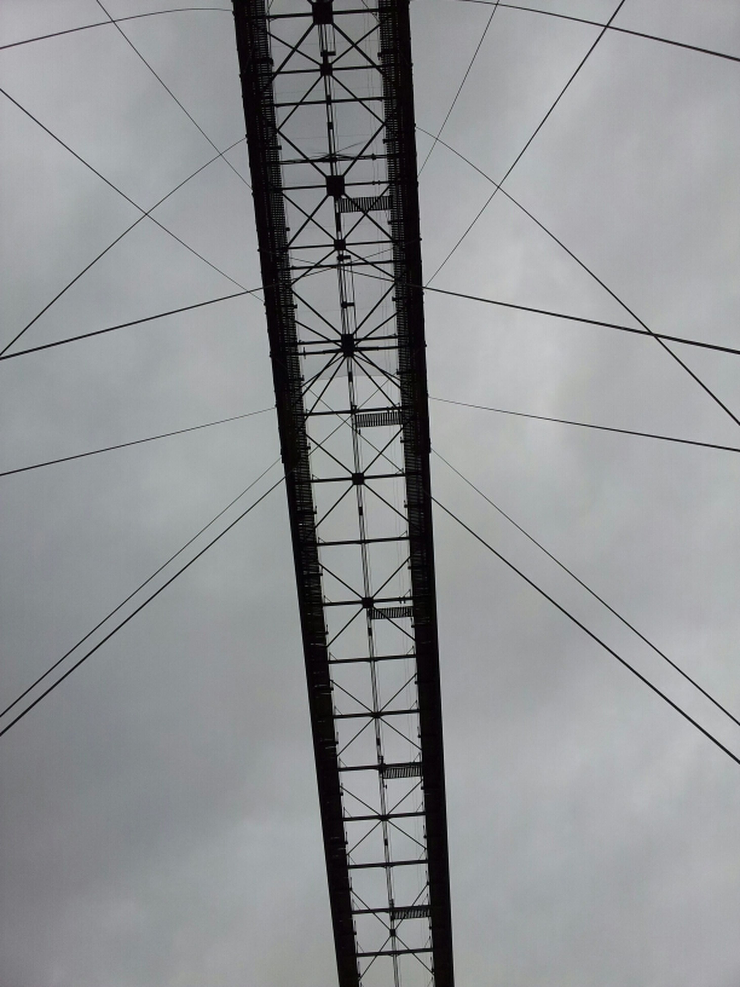 low angle view, power line, sky, power supply, electricity, connection, cable, electricity pylon, cloud - sky, cloudy, technology, fuel and power generation, cloud, no people, outdoors, day, built structure, power cable, backgrounds, silhouette