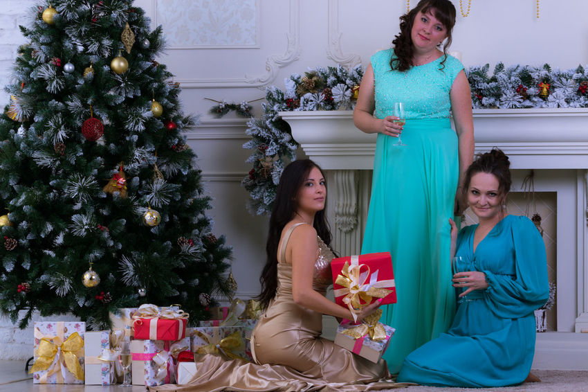 Christmas Tree Christmas Togetherness Three People Celebration Young Adult Smiling Young Women Friendship Christmas Present EyeEm Selects Elégance Christmas Spirit Christmas Eve Christmas Time Anticipation Christmas Party Beautiful Woman