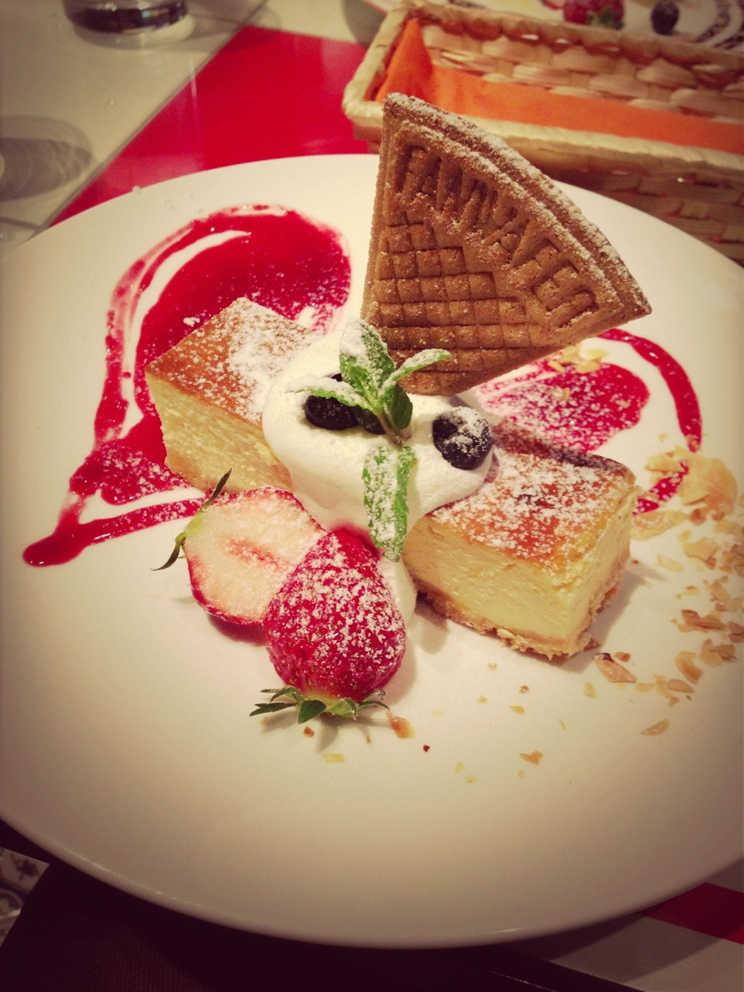 indoors, food and drink, food, freshness, plate, ready-to-eat, still life, sweet food, table, indulgence, dessert, strawberry, close-up, cake, fruit, high angle view, unhealthy eating, serving size, temptation