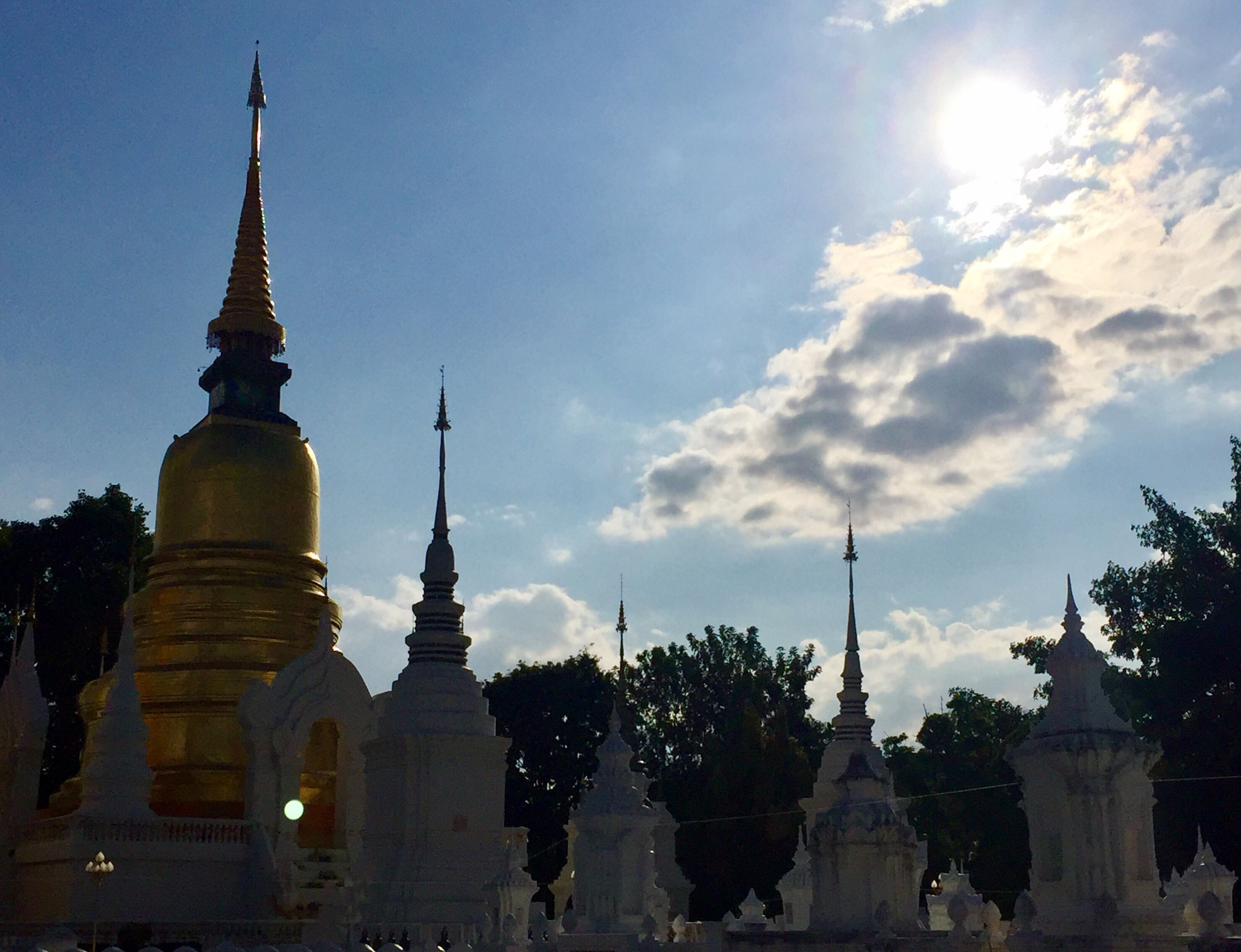 religion, sky, architecture, spirituality, place of worship, gold colored, pagoda, travel destinations, outdoors, built structure, tree, building exterior, no people, tourism, low angle view, city, gold, day
