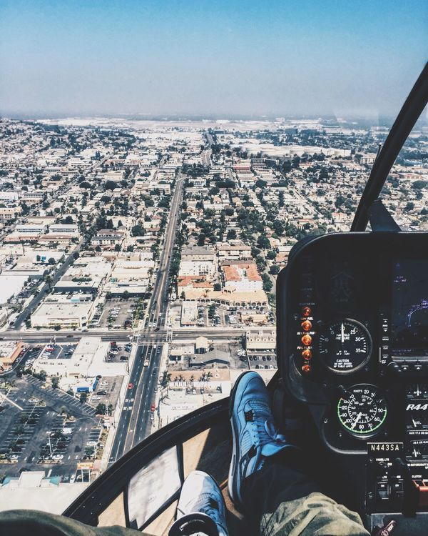 Helicopter tour Personal Perspective Aerial View On The Move Cityscape Travel Human Body Part Vehicle Interior Mid-air Air Vehicle Landscape Day Low Section Flying Mode Of Transport Lifestyles Airplane Human Leg One Person Built Structure Outdoors Long Goodbye
