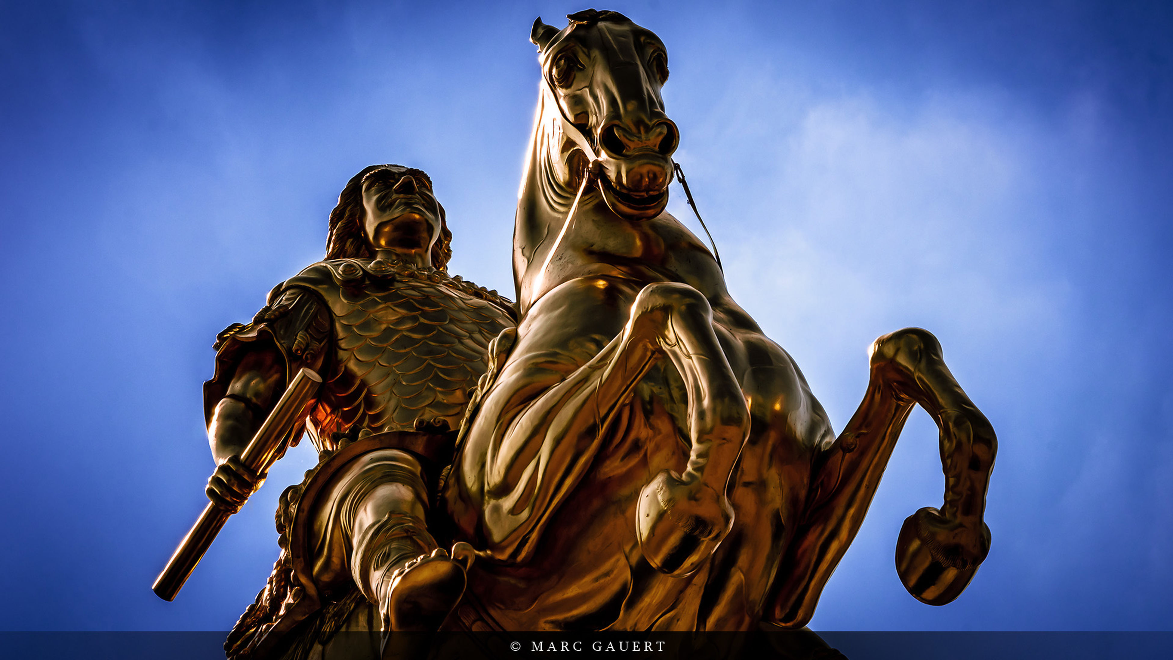 statue, human representation, sculpture, art and craft, art, low angle view, creativity, religion, spirituality, sky, carving - craft product, place of worship, animal representation, famous place, travel destinations, craft, travel