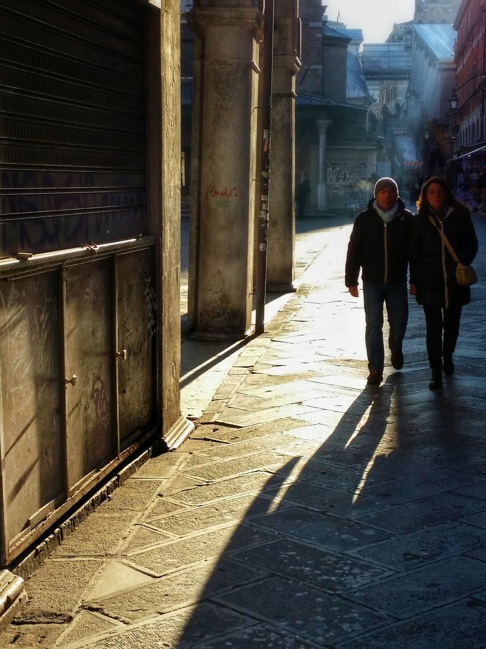 built structure, walking, architecture, sunlight, two people, real people, building exterior, full length, shadow, men, day, women, togetherness, outdoors, adult, people
