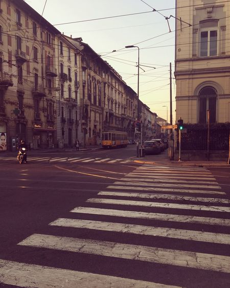 5am downtown Milan... Streetlife Building Exterior Early Morning Motorbiker Tram Crossings Transportation Cityliving Lovetotravel Lovelife